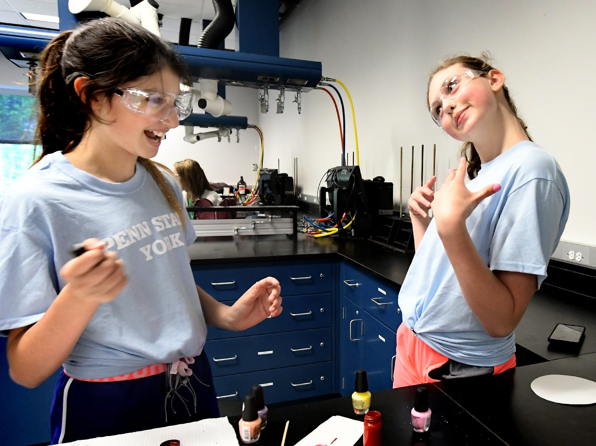 Dallastown Middle School student Elliot Post-Kulisiewicz shows off the nail polish she applied to classmate Emerson Dunker, left, during The Science of Color in Cosmetics workshop at the Pathways to Your Future: Exploring STEAM Careers event at Penn State York Friday, May 10, 2019. Over 200 seventh-grade girls from 28 area schools participated in the program which highlighted science, technology, engineering, art, and mathematics (STEAM) careers. Industry leaders administered the workshops during the program, which is in its 23rd year. Bill Kalina photo