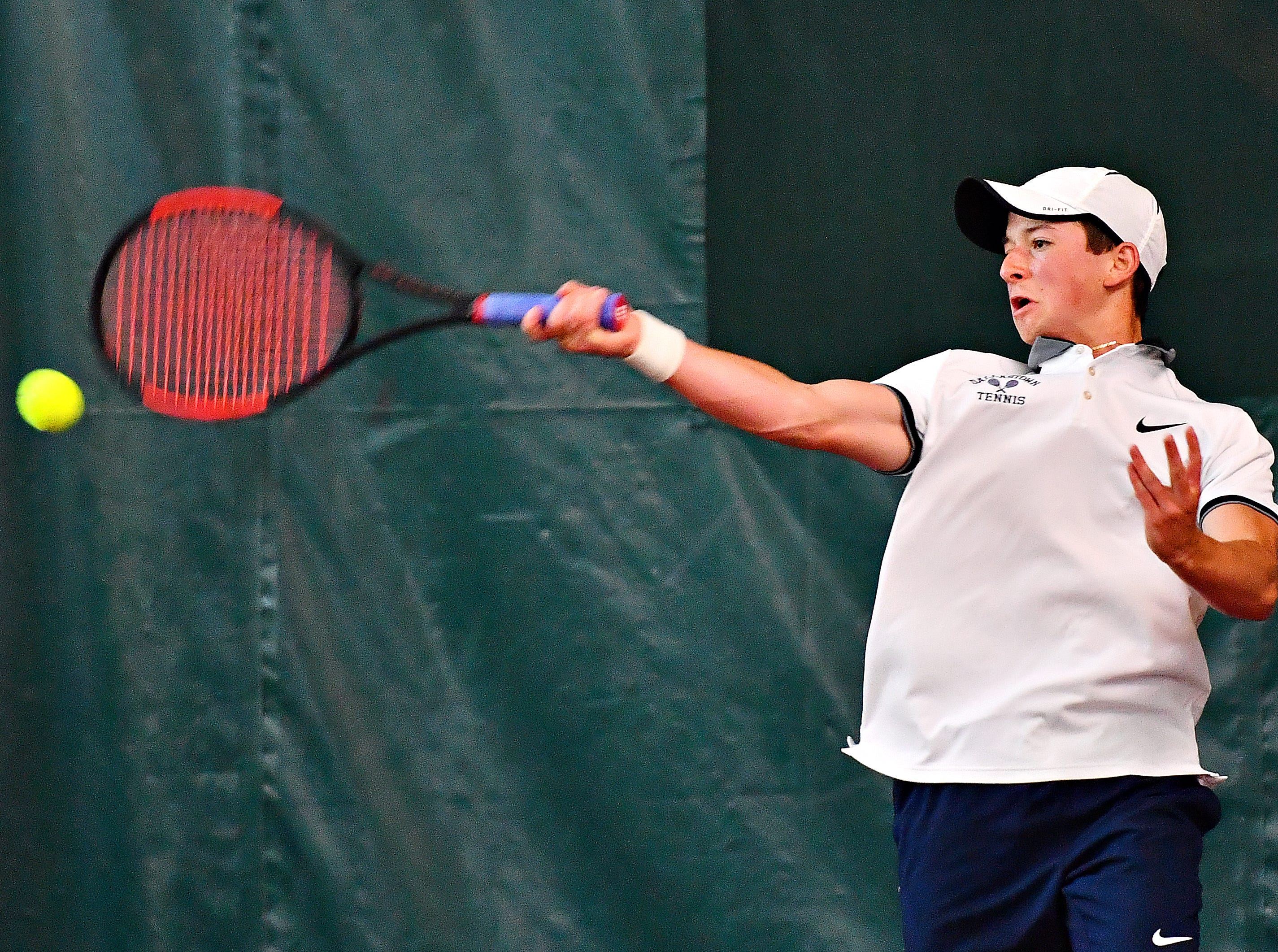 Dallastown's Jonathan Burns returns the ball to Hershey's Andy Chen during District III, Class 3-A boys' tennis team championship action at Hershey Raquet Club in Hershey, Thursday, May 9, 2019. Chen would win the match and Hershey would win the title. Dawn J. Sagert photo