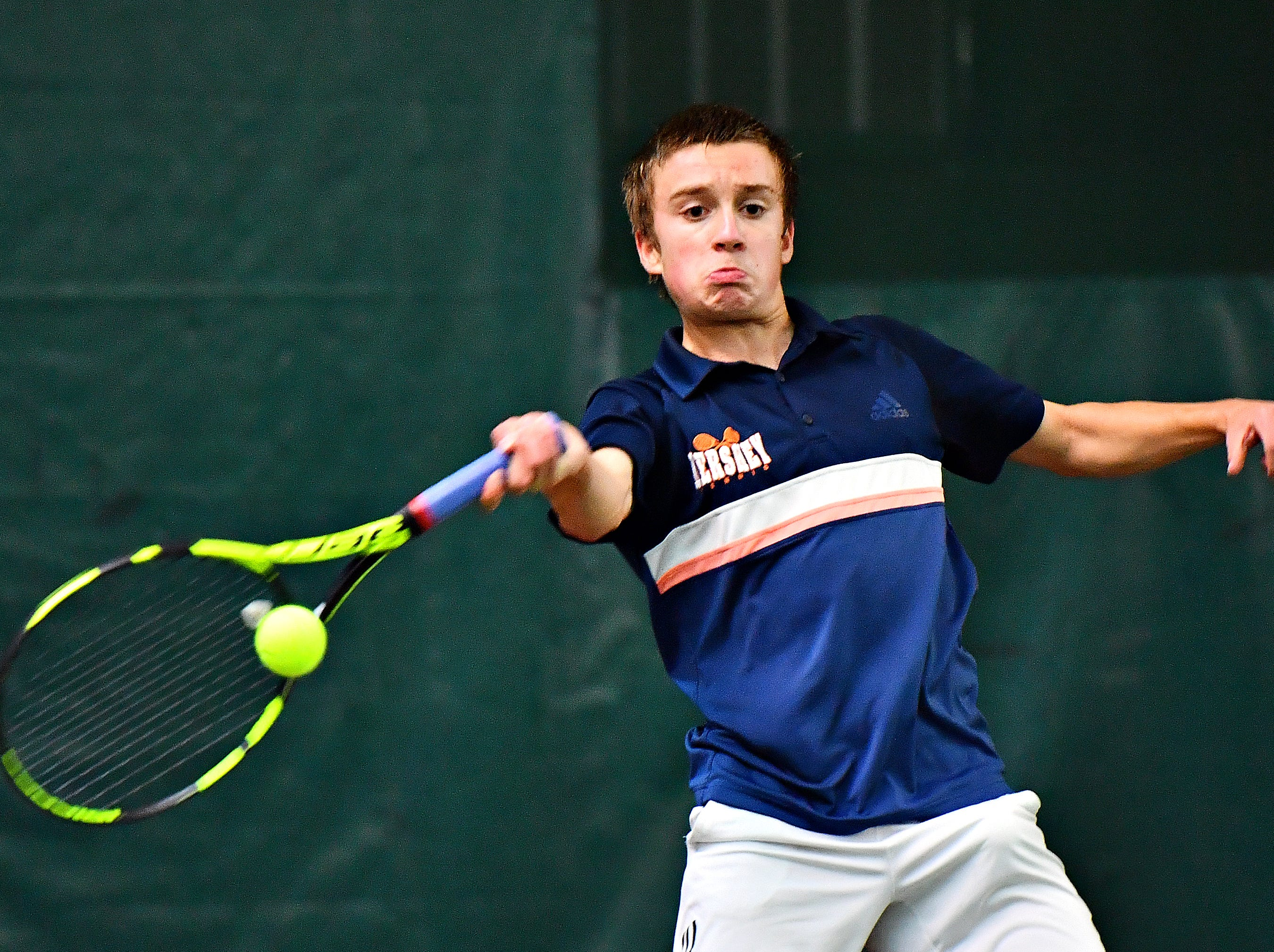 Hershey's Andreas Wingert returns the ball to Dallastown's Holden Koons during District III, Class 3-A boys' tennis team championship action at Hershey Raquet Club in Hershey, Thursday, May 9, 2019. Koons would win the match and Hershey would win the title. Dawn J. Sagert photo