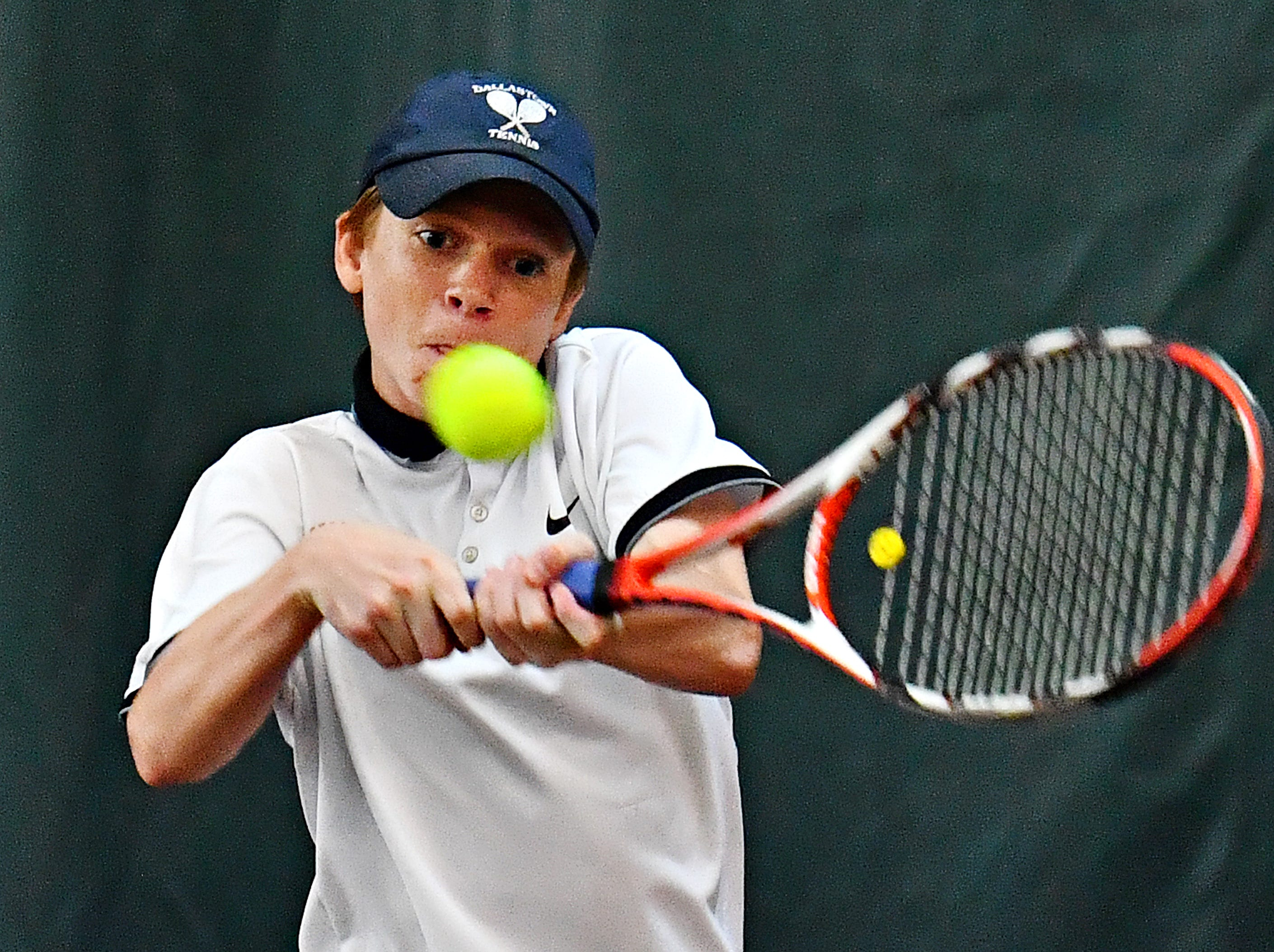 Dallastown's Noah May returns the ball to Hershey during District III, Class 3-A boys' tennis team championship doubles action at Hershey Raquet Club in Hershey, Thursday, May 9, 2019. Hershey would win the match as well as the title. Dawn J. Sagert photo