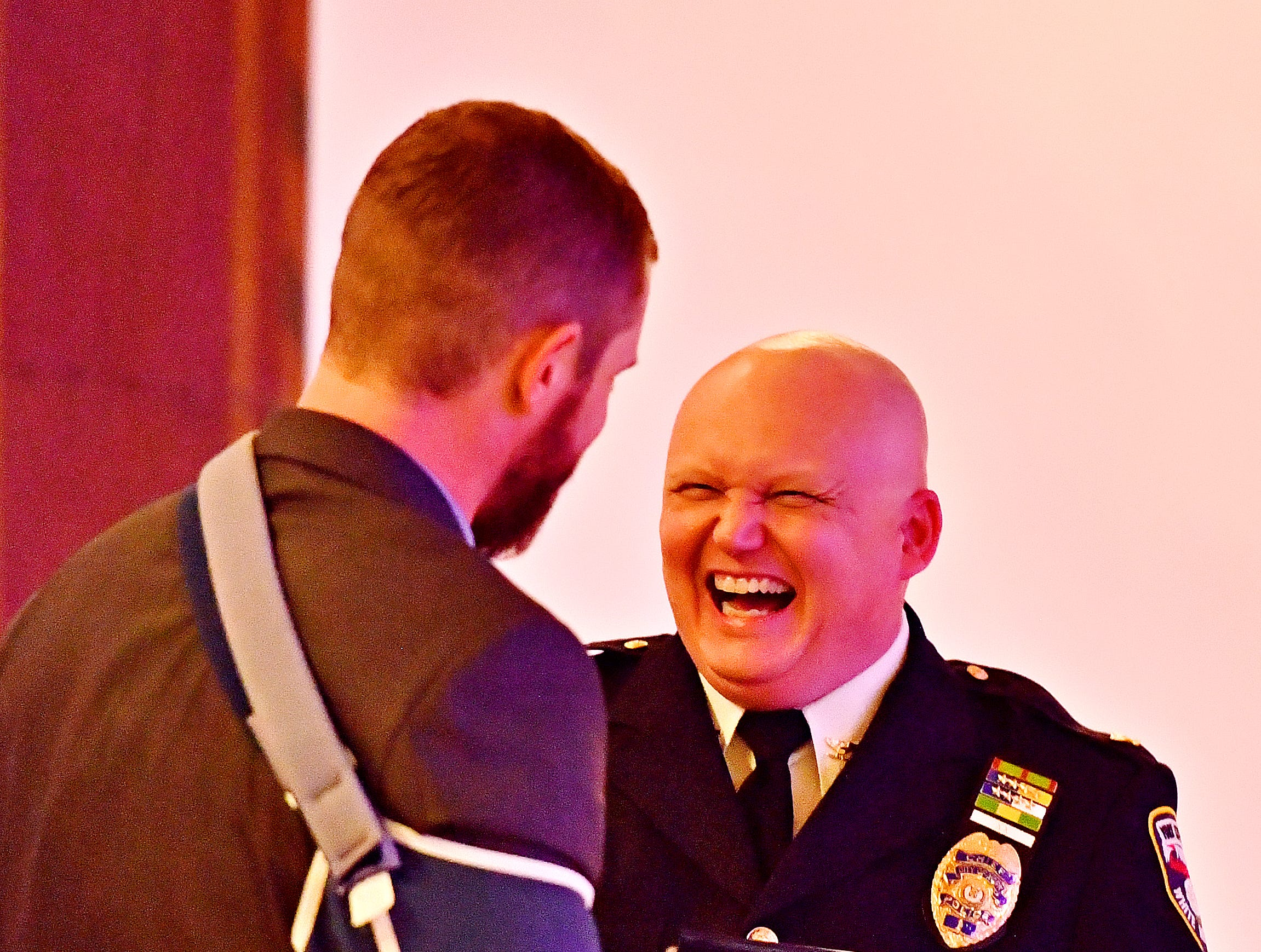 """York City Police Officer Kyle Pitts, left, is awarded the 2018 """"Wound Bar"""" award by York City Police Chief Troy Bankert during the York City Police Departmental Awards Ceremony at Valencia Ballroom in York City, Thursday, May 9, 2019. Dawn J. Sagert photo"""