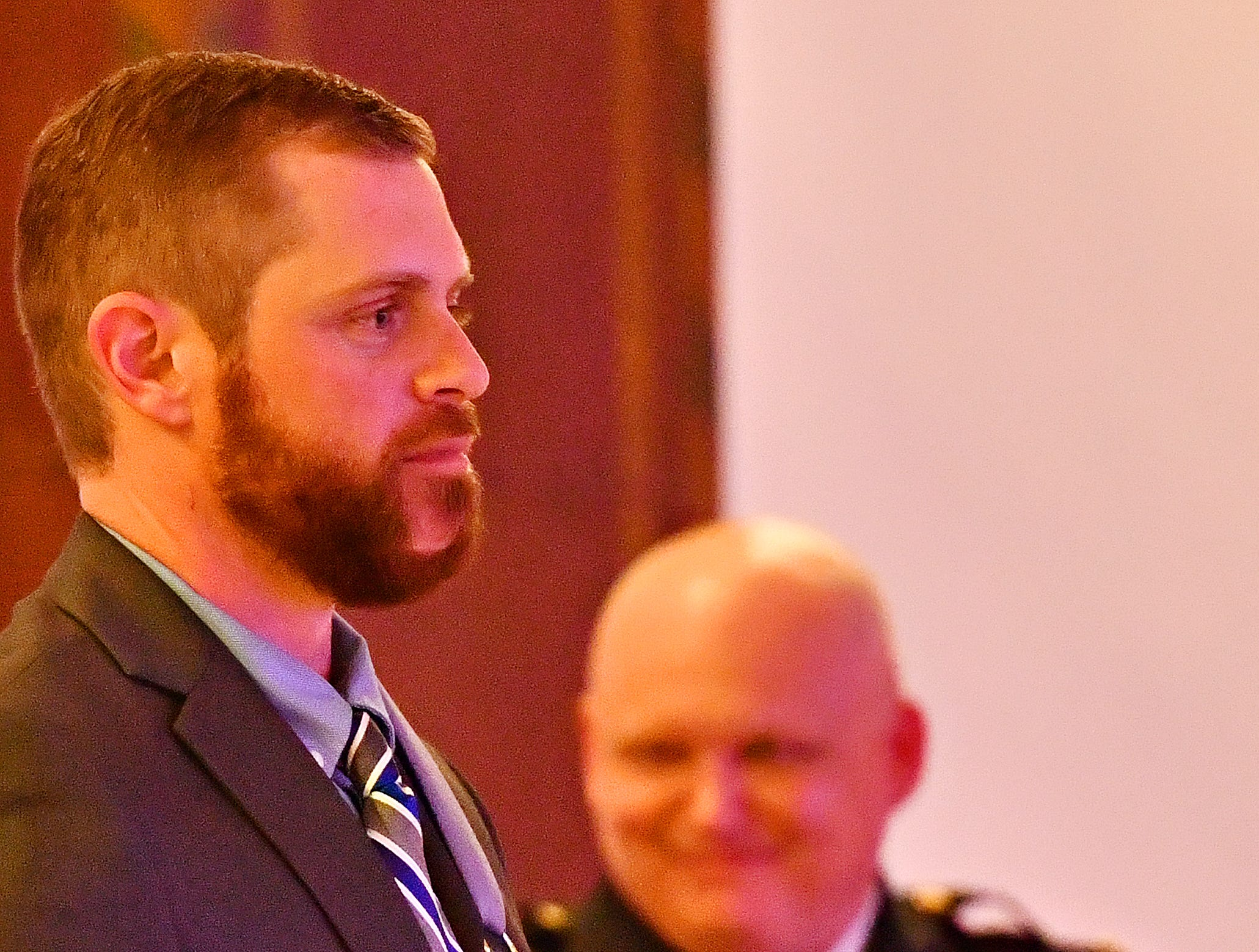 """York City Police Officer Kyle Pitts, left, is applauded as he receives the 2018 """"Wound Bar"""" award by York City Police Chief Troy Bankert during the York City Police Departmental Awards Ceremony at Valencia Ballroom in York City, Thursday, May 9, 2019. Dawn J. Sagert photo"""