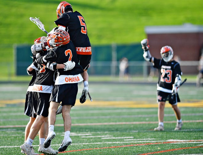 Central York celebrates its 13-5 victory over York Catholic on Friday night in the York-Adams League boys' lacrosse title game.