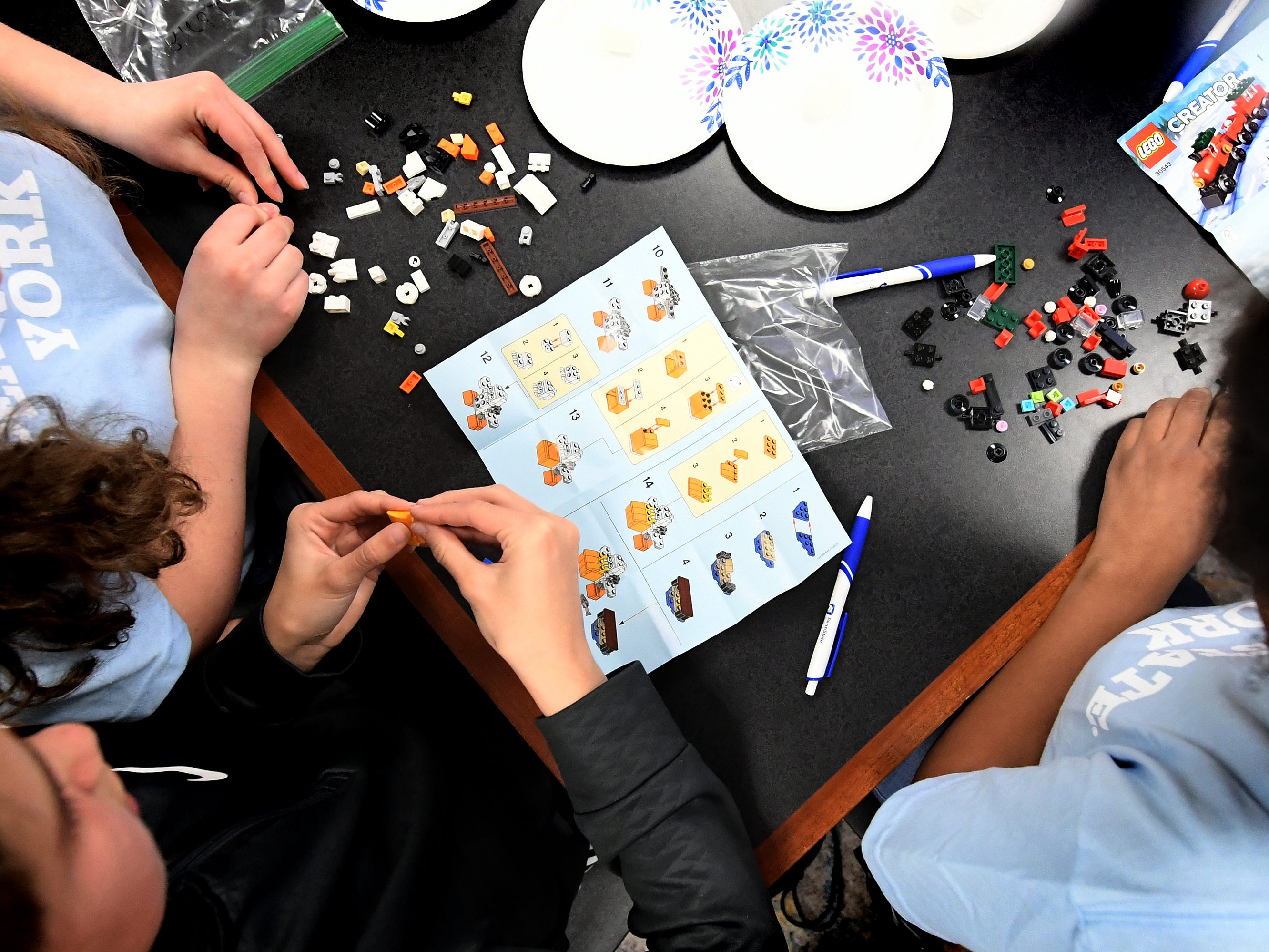 South Eastern Middle School students work on a puzzle during Marshmallow Minds, a social science workshop at the Pathways to Your Future: Exploring STEAM Careers event at Penn State York Friday, May 10, 2019. Over 200 seventh-grade girls from 28 area schools participated in the program which highlighted science, technology, engineering, art, and mathematics (STEAM) careers. Industry leaders administered the workshops during the program, which is in its 23rd year. Bill Kalina photo
