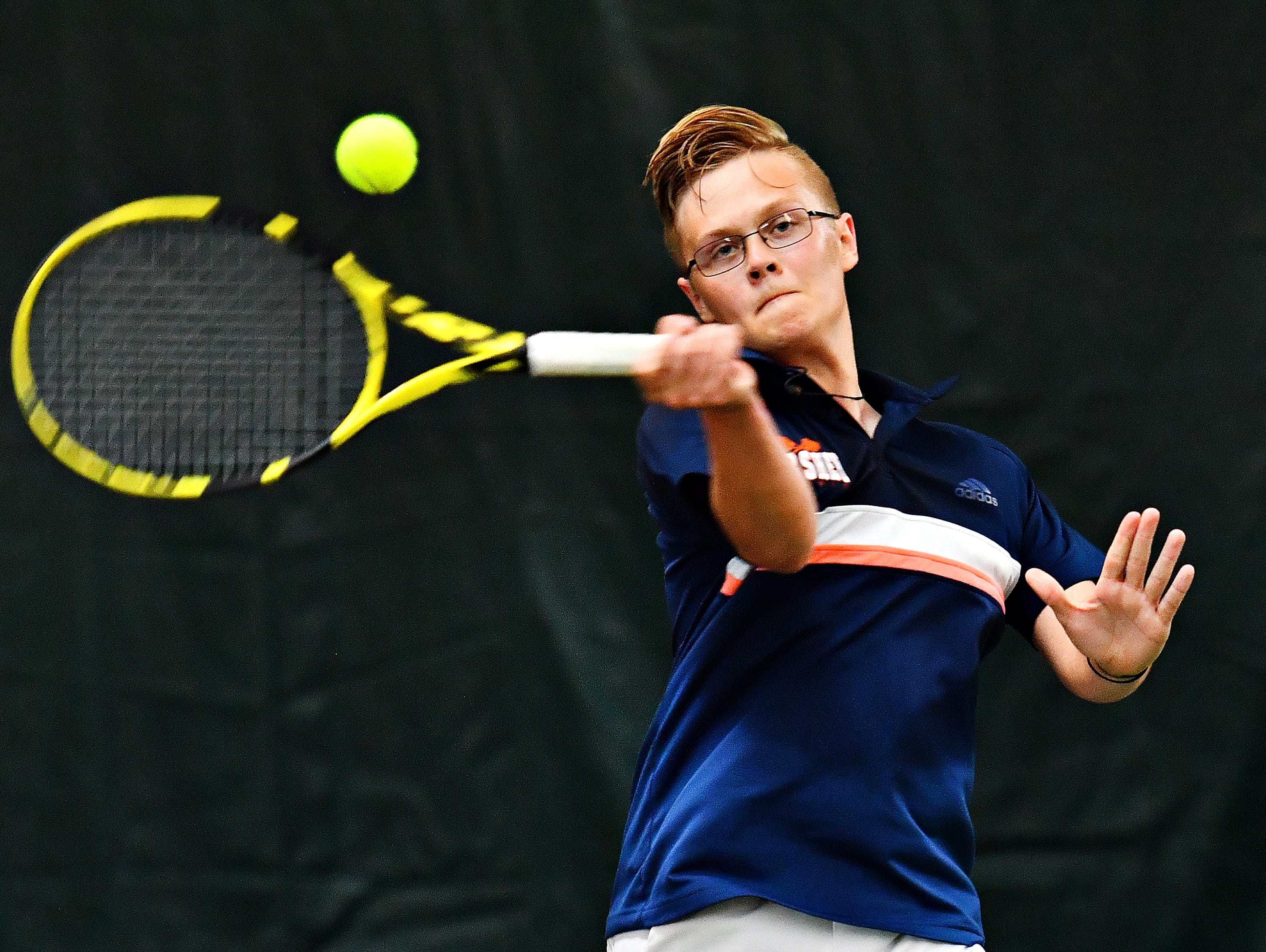 Hershey's Andrew Schreck returns the ball to Dallastown during District III, Class 3-A boys' tennis team championship doubles action at Hershey Raquet Club in Hershey, Thursday, May 9, 2019. Dallastown would win the match, but Hershey would secure the title. Dawn J. Sagert photo