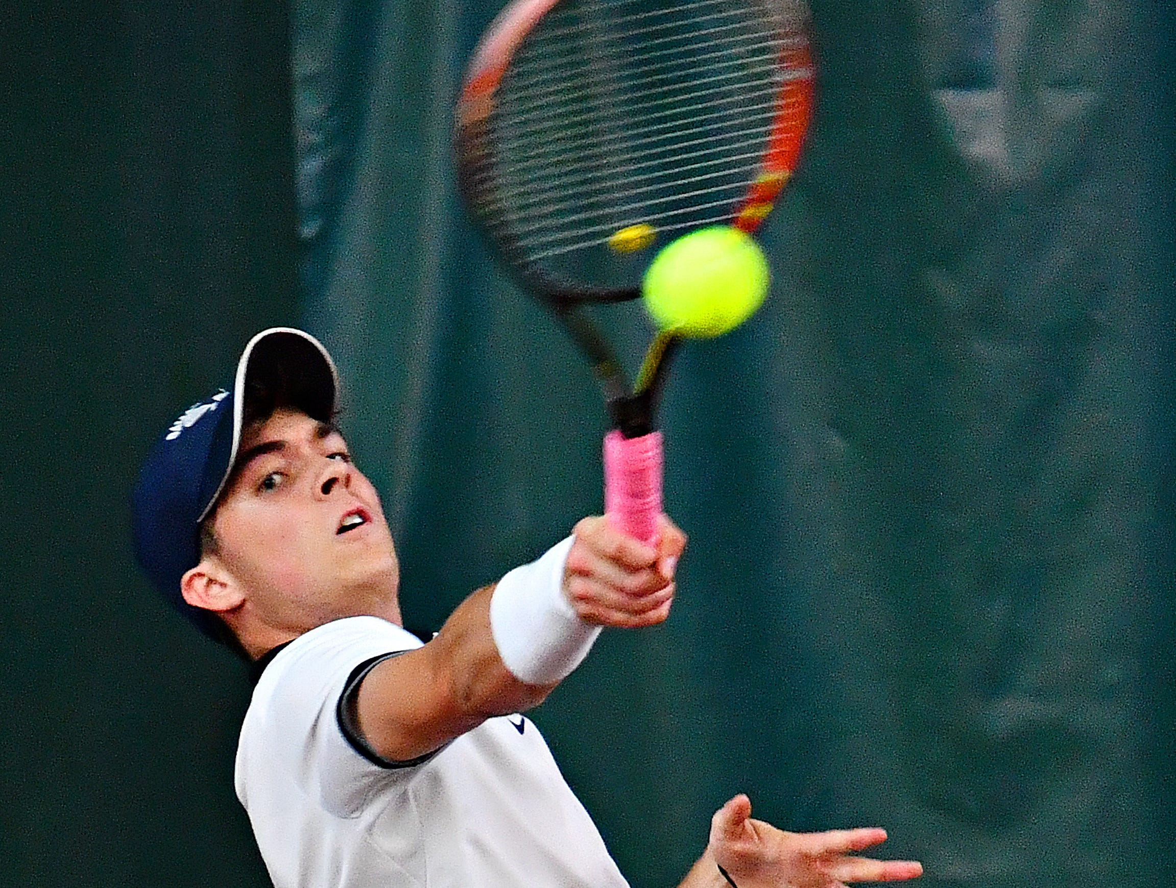 Dallastown's Sebastian May returns the ball to Hershey's Anthony Eichman during District III, Class 3-A boys' tennis team championship action at Hershey Raquet Club in Hershey, Thursday, May 9, 2019. Eichman would win the match and Hershey would win the title. Dawn J. Sagert photo