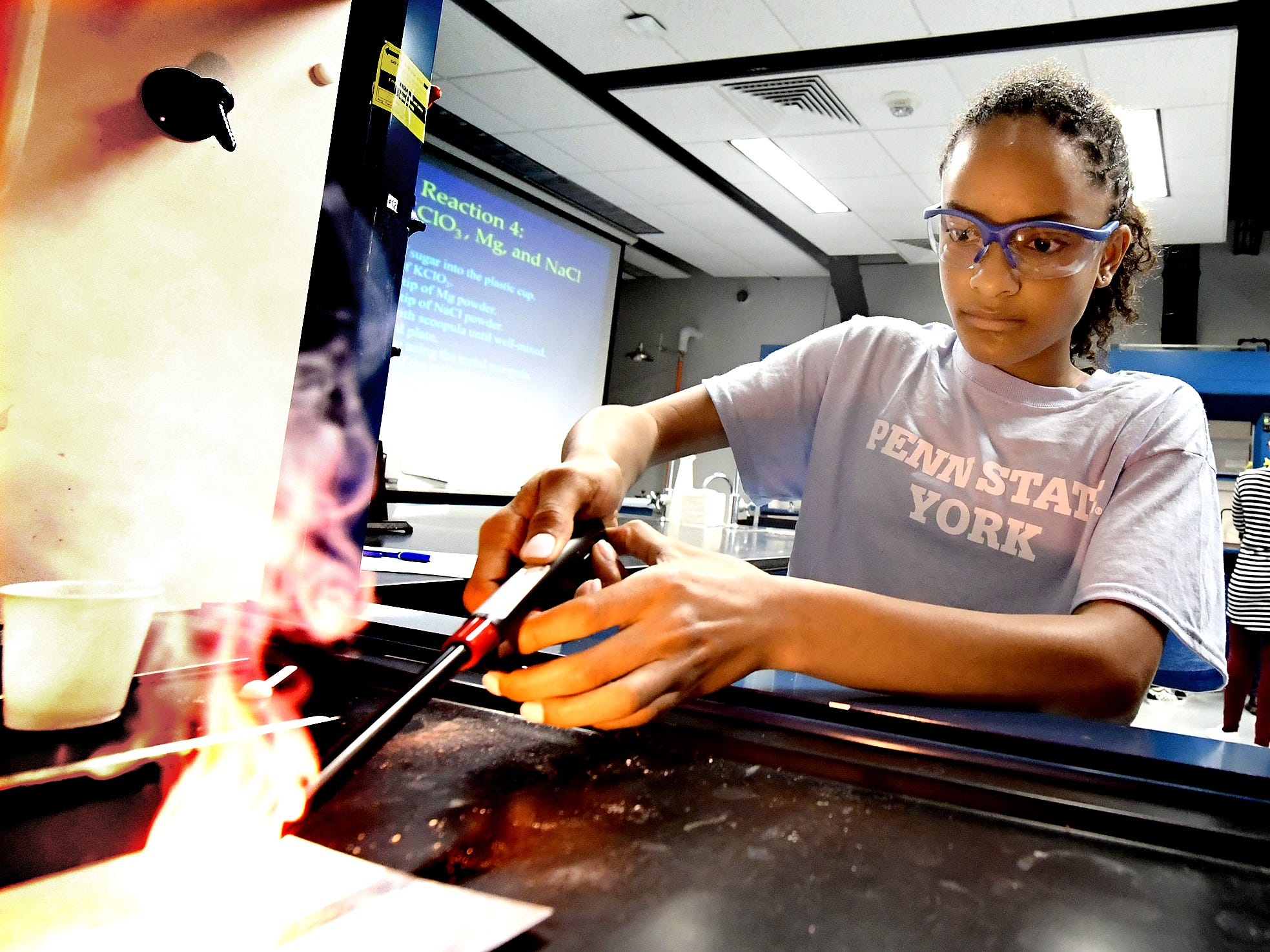 Harrisburg Academy student Sarah Henry lights a mixture during the Sparkling with Chemistry workshop at the Pathways to Your Future: Exploring STEAM Careers event at Penn State York Friday, May 10, 2019. Over 200 seventh-grade girls from 28 area schools participated in the program which highlighted science, technology, engineering, art, and mathematics (STEAM) careers. Industry leaders administered the workshops during the program, which is in its 23rd year. Bill Kalina photo