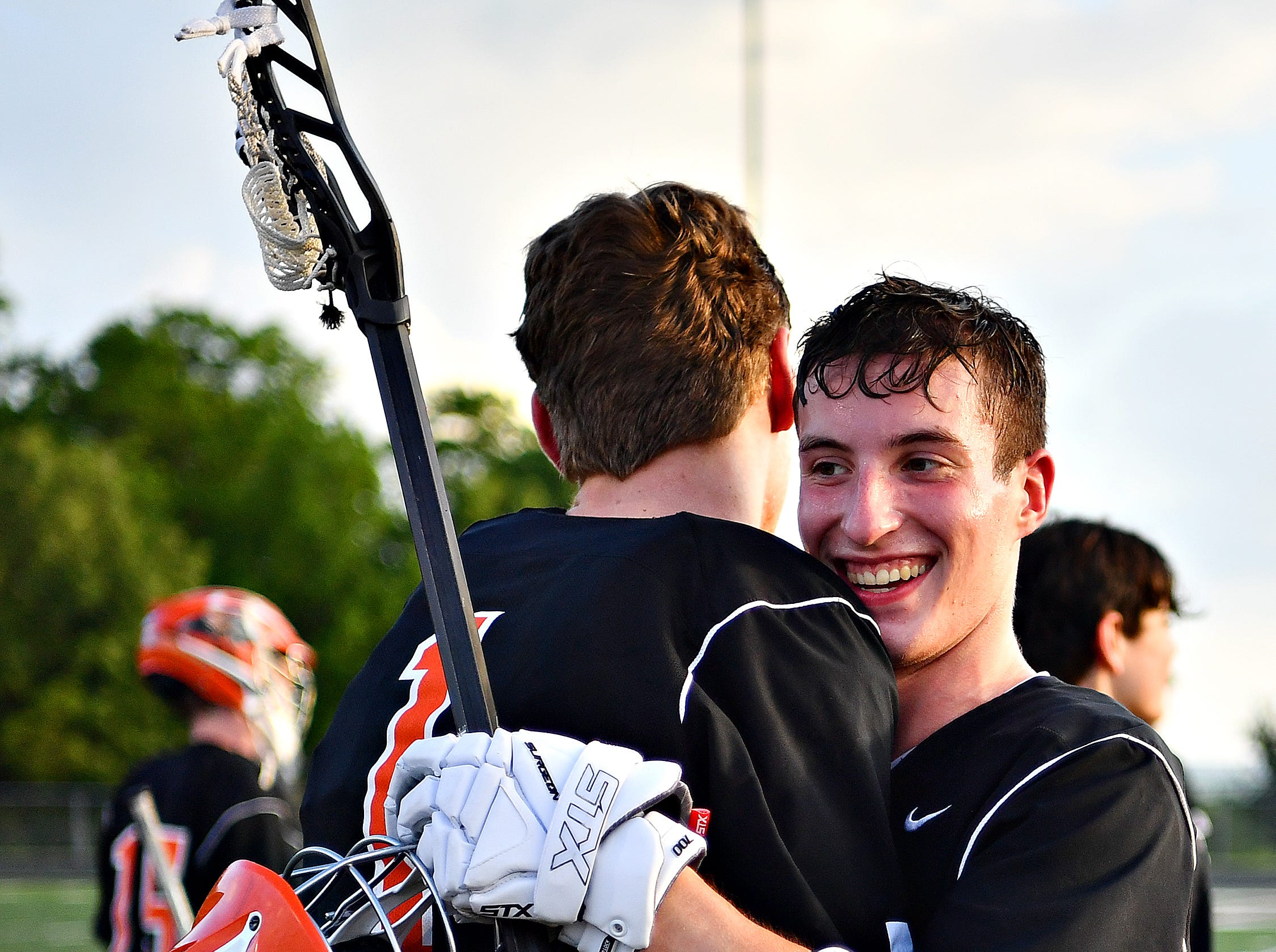 Central York celebrates a 13-5 win over York Catholic during lacrosse championship action at Eastern York Senior High School in Wrightsville, Friday, May 10, 2019. Dawn J. Sagert photo
