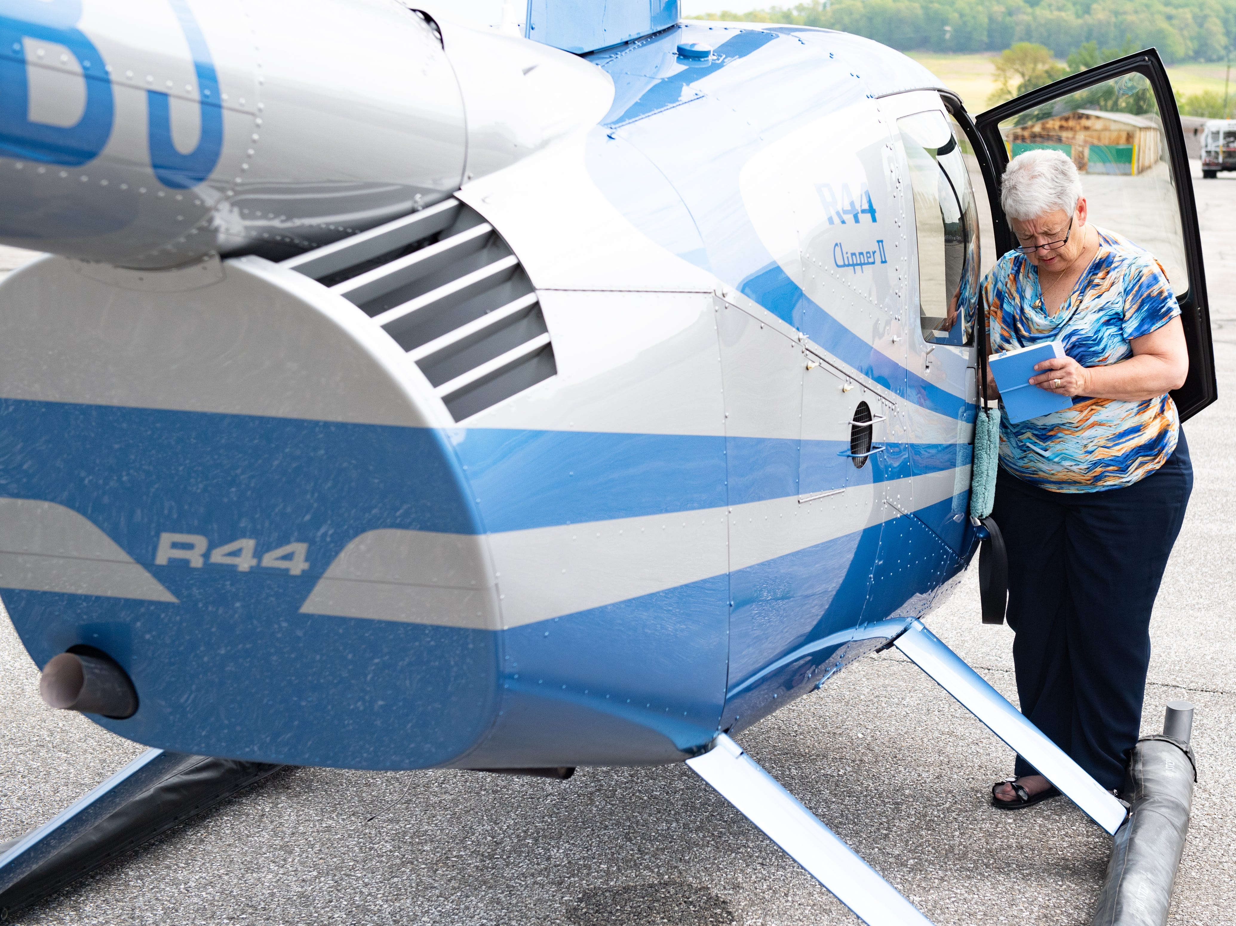 After every flight, Judith Redlawsk checks her helicopter thoroughly to make sure no damage was sustained in the air, May 2, 2019.