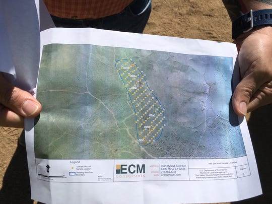 Kurt Miers of the Bureau of Land Management shows a map of an area near Reno that's polluted by target shooting and illegal dumping.