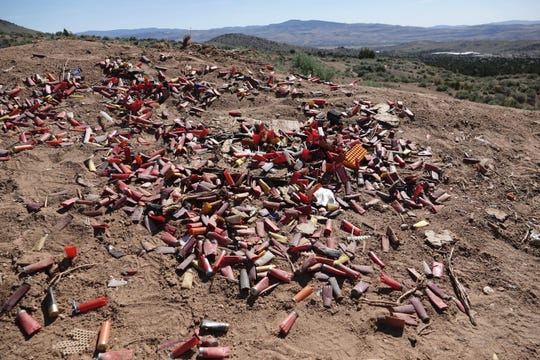 Debris left behind by target shooters on the northern outskirts of Reno, Nev. The Bureau of Land Management says shooting sites can show lead contamination at four times the amount of what's considered safe for residential areas.