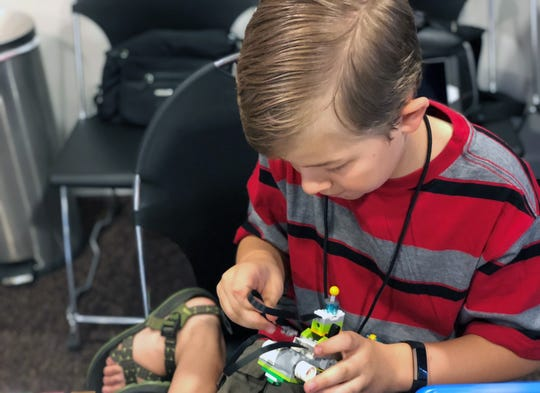 A student works on a Lego robot during Reno Technology Academy's summer robotics camp in 2018.