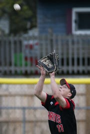 Penfield center fielder Connor Stuewe (11) makes this catch for an out against Irondequoit.
