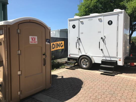 The white trailer houses the two new bathrooms at The Park food truck court in downtown Redding.