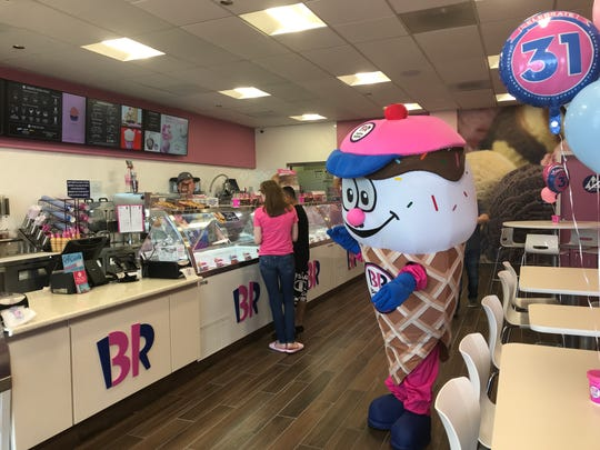 Coney, the Baskin-Robbins mascot, greets customers at the store's opening Friday.