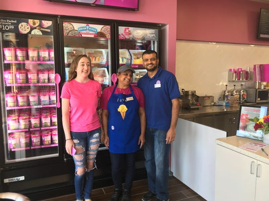 Jaime Heffley, left, stands with Redding Baskin-Robbins owners Manisha Patel and Peter Patel. Heffley won a $100 gift card because she was the first customer.