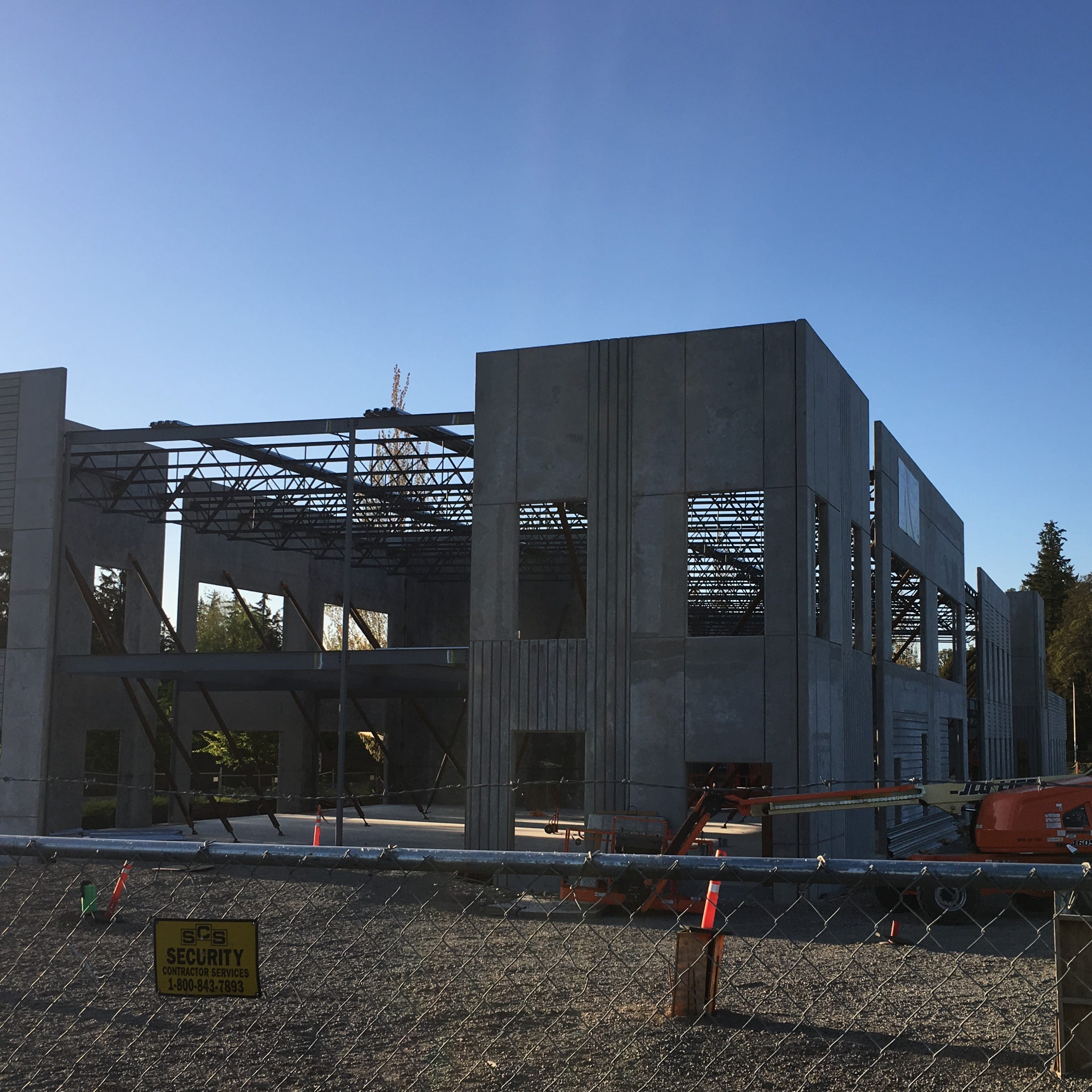 What's being built near the Woodburn Premium Outlets?