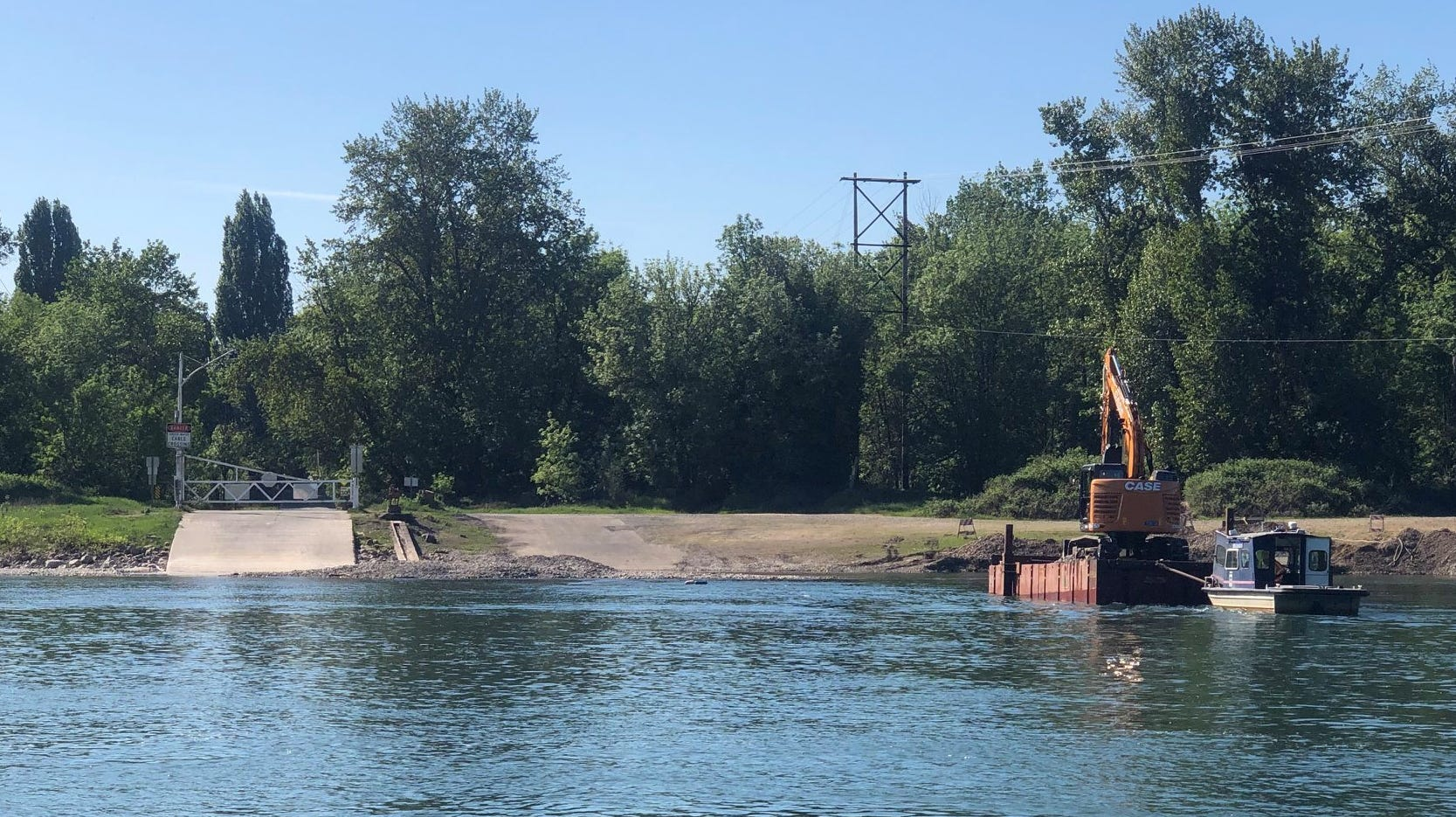 A mound of rock yet to be removed can be seen between the ferry ramp and boat ramp at the Wheatland Ferry Wednesday, May 8, 2019.
