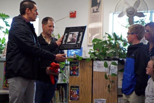 Bardin Elementary School Principal Martin Gutierrez holds the plaque dedicated to longtime teacher Jacqueline Moser. May 10, 2019.