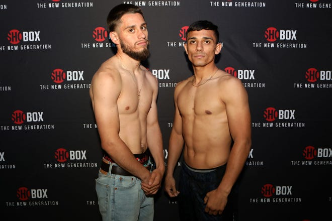 Ruben Villa IV and Luis Alberto Lopez pose post weigh-in Thursday in Corona, Calif.