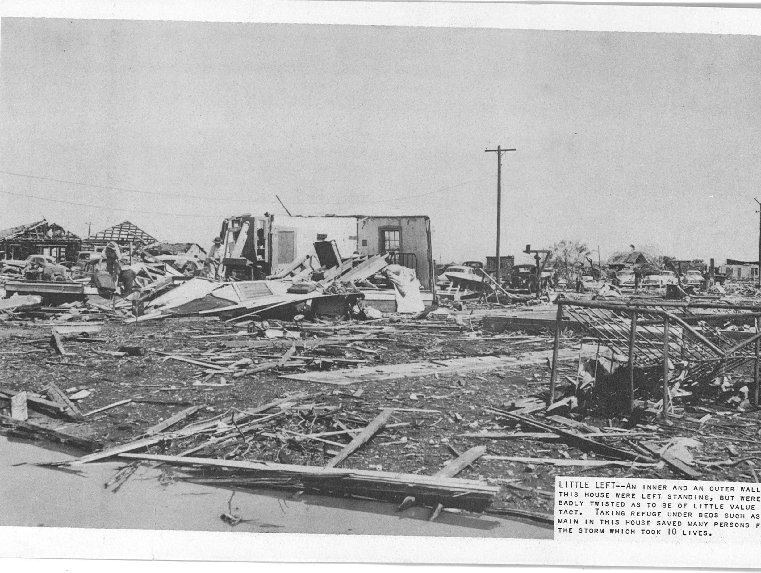 The Lake View tornado on May 11, 1953, decimated many homes like this one on May 11, 1953. The original cut-line reads: An inner and an outer wall of this house were left standing, but were so badly twisted as to be of little value intact. Taking refuge under beds such as remain in this house saved many persons from the storm with took 10 lives. The tornado killed 18 people.