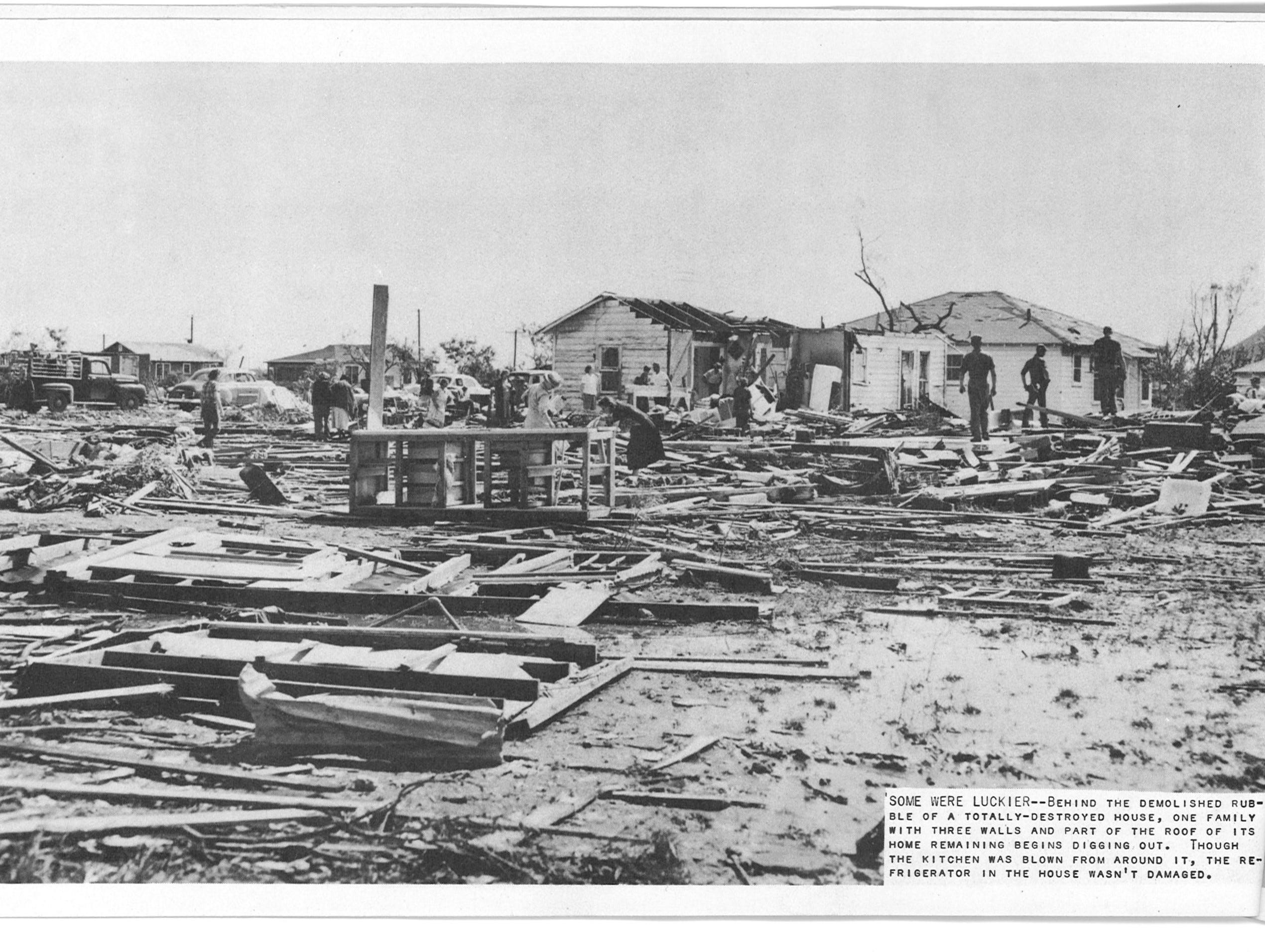 The Lake View tornado caused over $2 million in damages on May 11, 1953. The original cut-line reads: Behind the demolished rubble of a totally-destroyed house, one family with three walls and part of the roof of its home remaining begins digging out. Through the kitchen was blown from around it, the refrigerator in the house wasn't damaged.