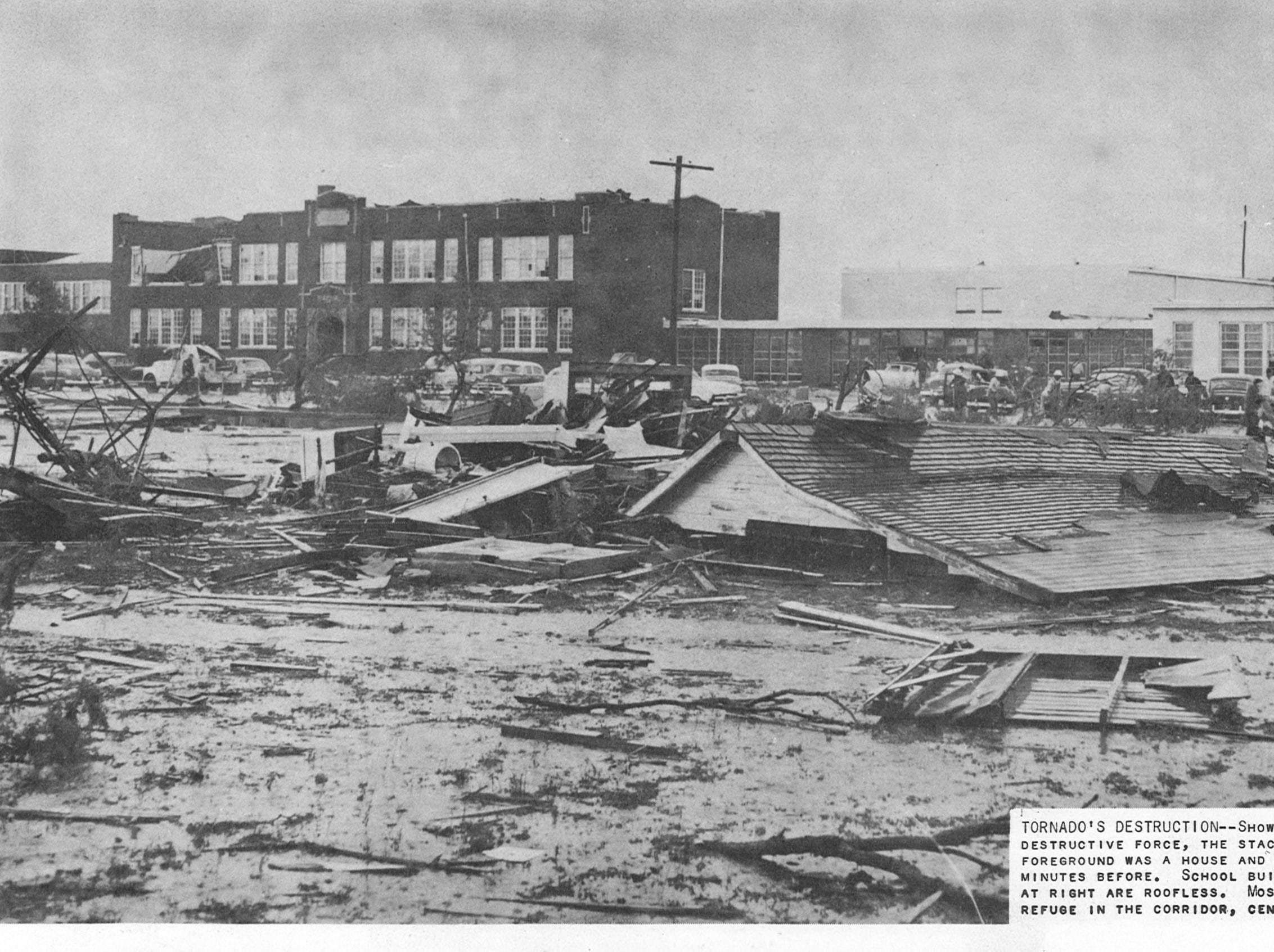 While parts of Lake View's school stood strong against the EF-4 Lake View tornado on May 11, 1953, some buildings were obliterated. The cut-line reads: Showing the tornado's destructive force, the stack of rubble in foreground was a house and its furnishing minutes before. School building extensions at right are roofless. Most students took refuge in the corridor, center background.