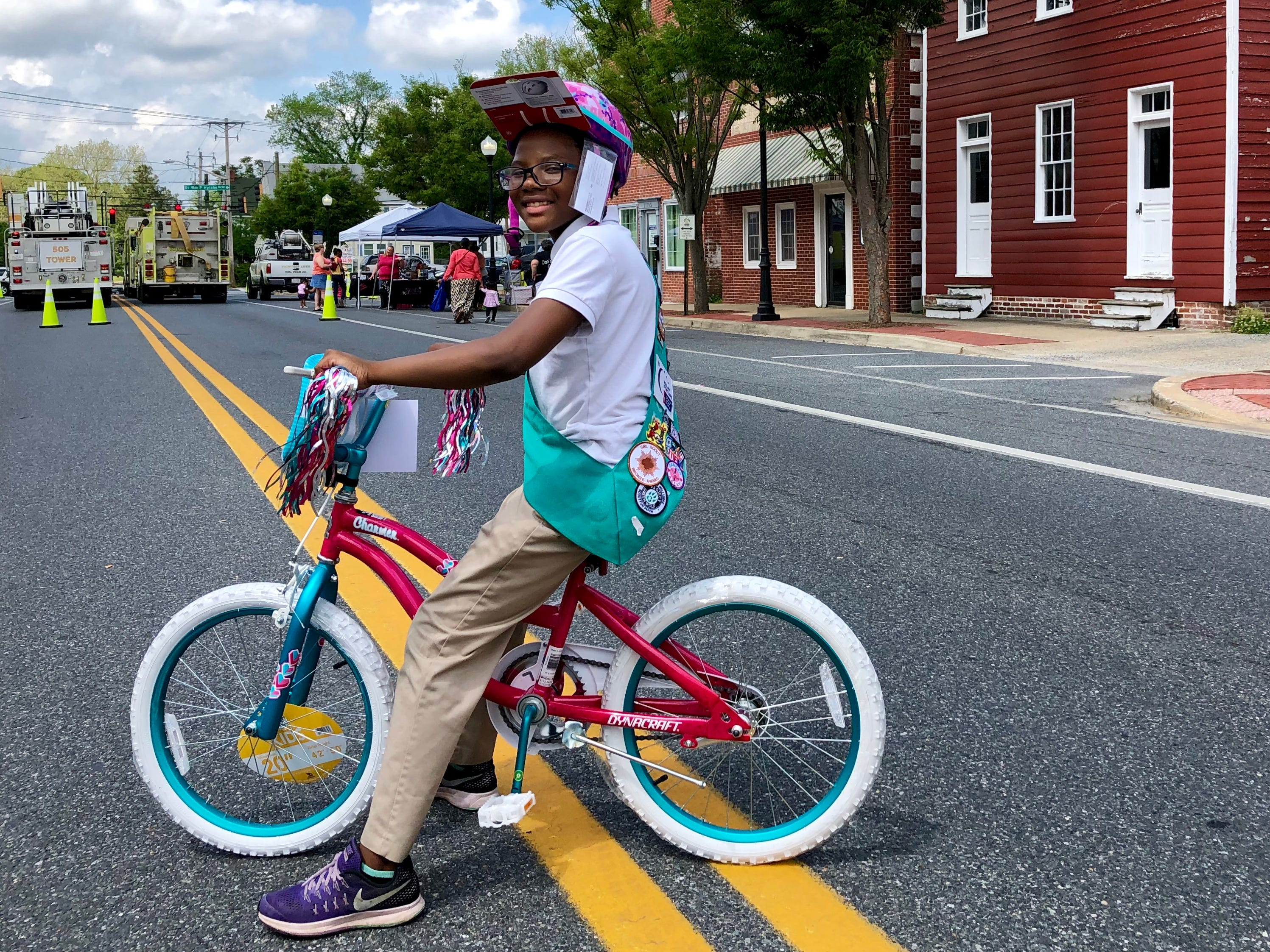 Amara Hankerson, 10, a student at Greenwood Elementary and a member of Girl Scout Troop 1285, won one of four bicycles given away at Street Fest. The bicycles, given away by the Princess Anne Chamber of Commerce, were sponsored by Farmers Bank of Willards.