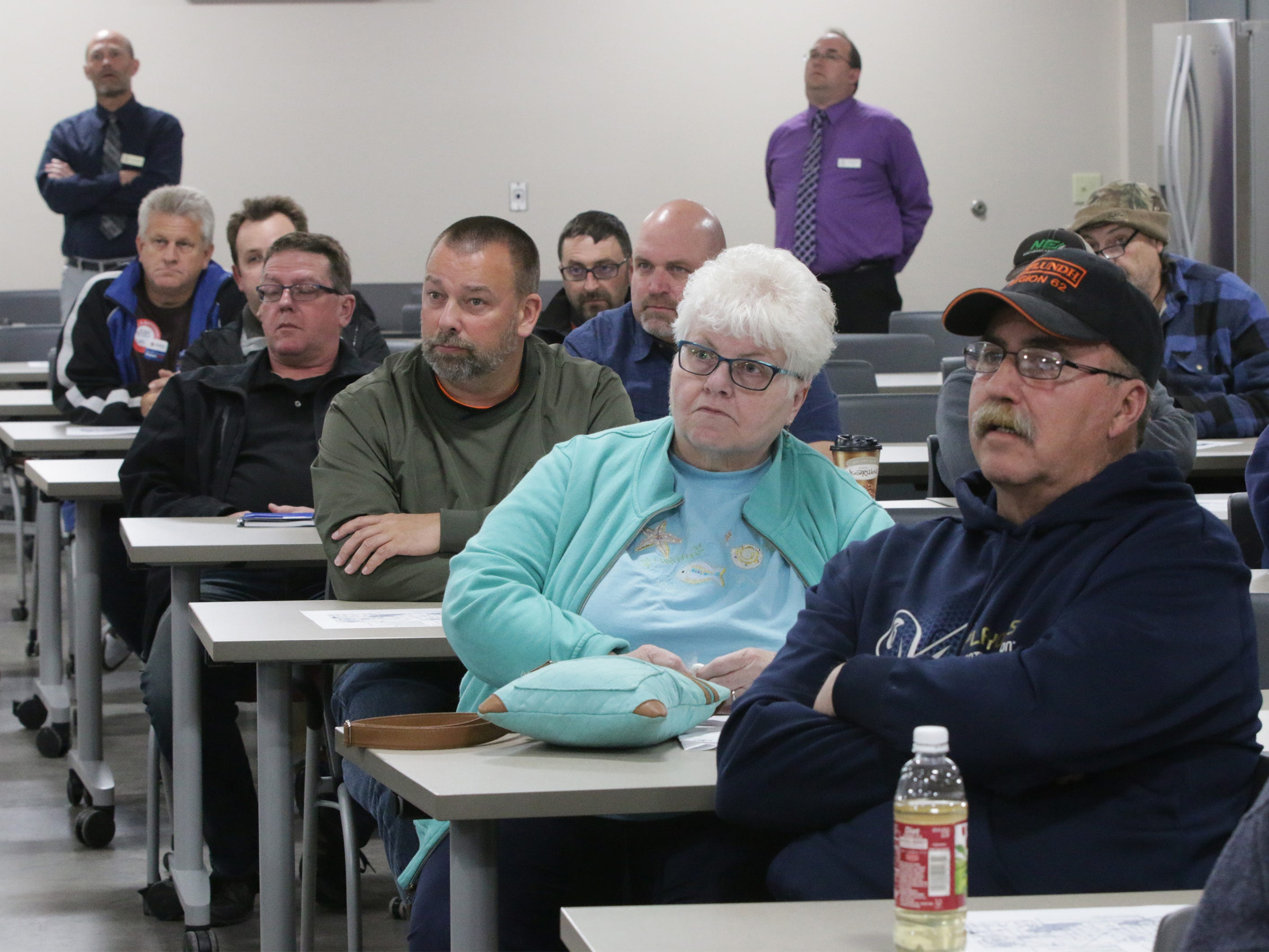 People listen to a discussion of the state Highway 23 four-lane construction project during a meeting at the Sheboygan County Transportation facility, Thursday, May 9, 2019, in Plymouth, Wis.