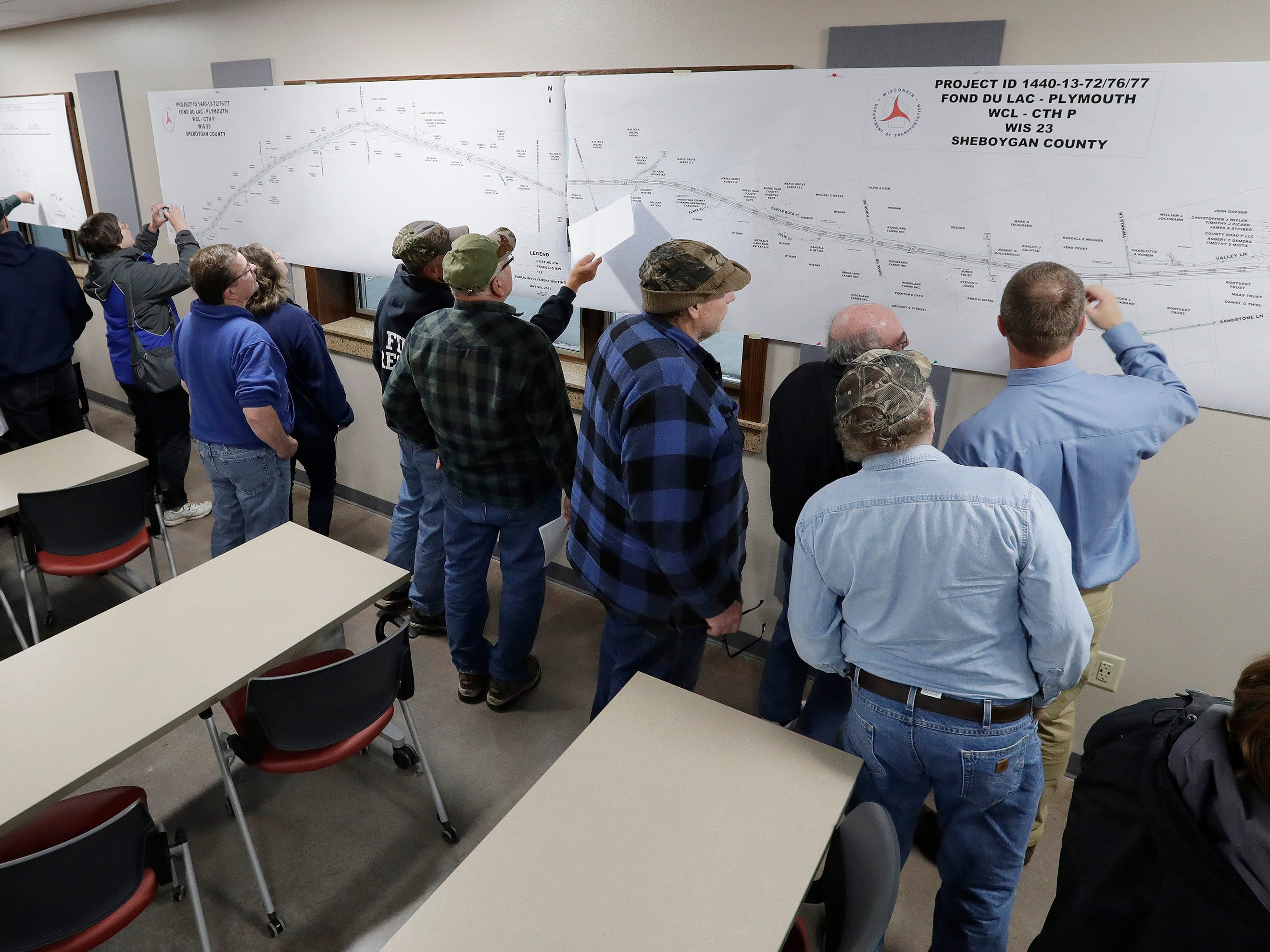 People look over state Highway 23 plans at the Sheboygan County Transportation Facility, Thursday, May 9, 2019, in Plymouth, Wis.  DOT officials displayed the construction plans for the state Highway 23 four-lane construction project.