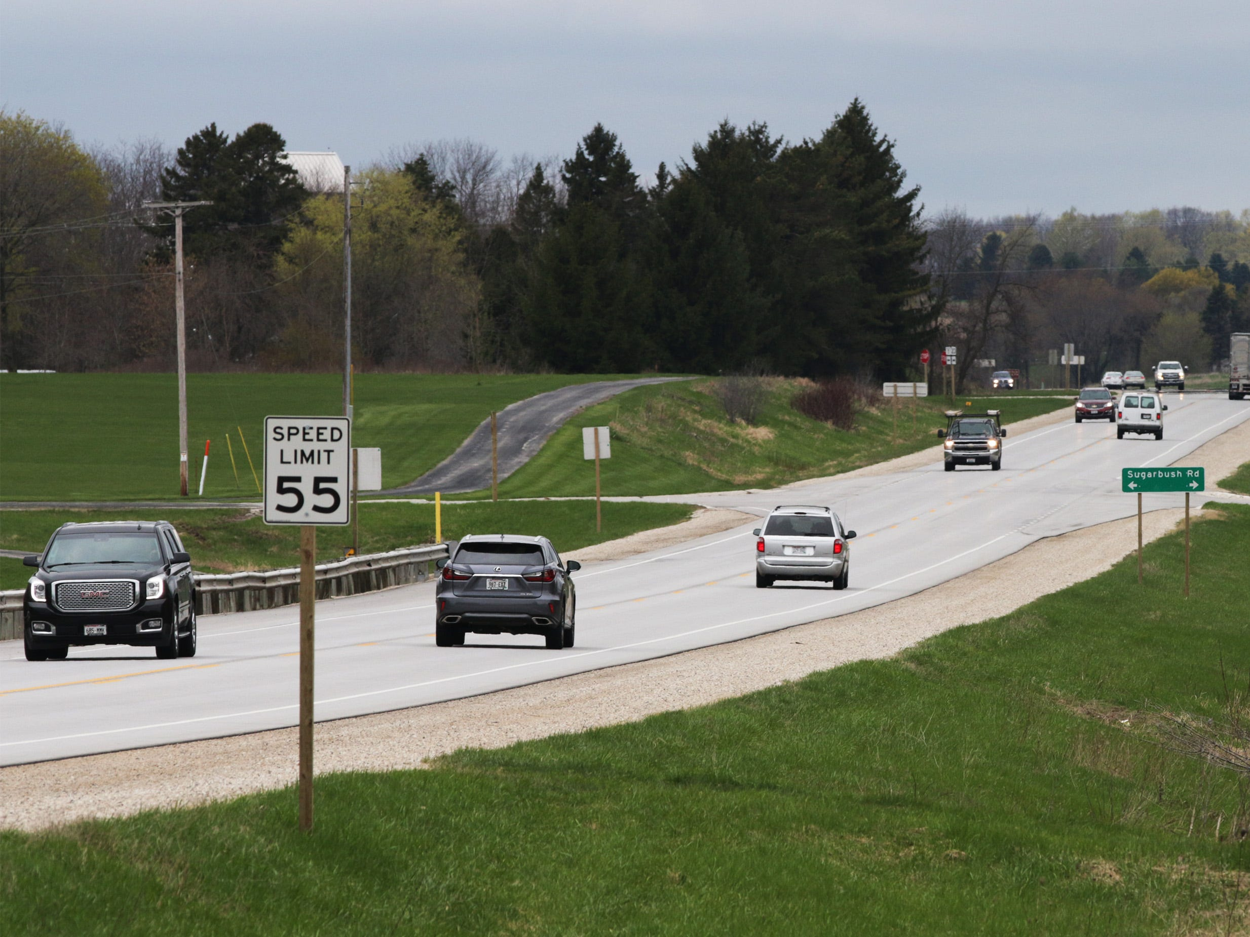 Vehicles travel west of the Wade House, Thursday, May 9, 2019, in Greenbush, Wis. State Highway 23 four-lane construction project will start next week.