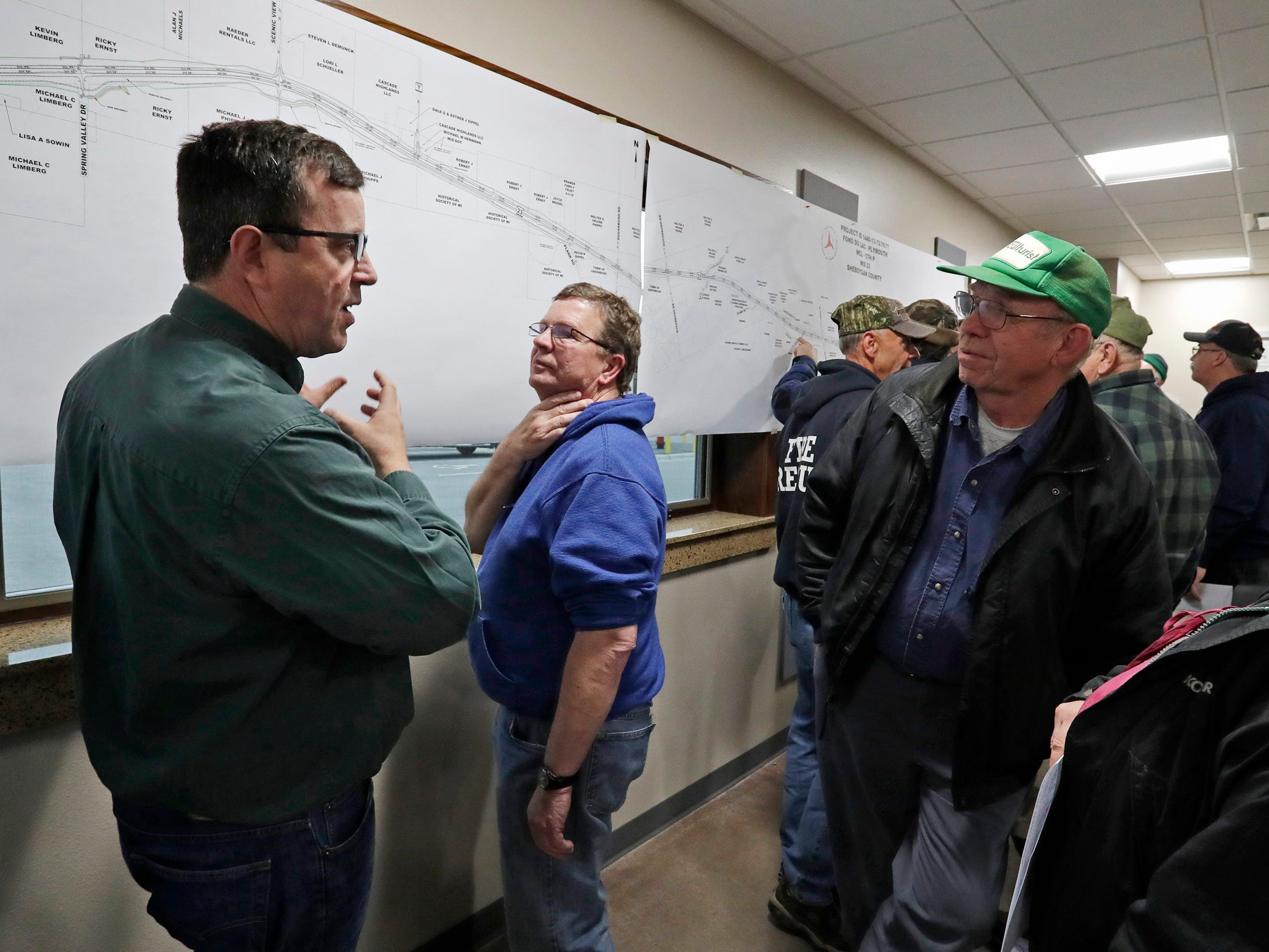Relyco's Tom Ceske, left, talks to people impacted by the state Highway 23 four-lane construction project at meeting at the Sheboygan County Transportation facility, Thursday, May 9, 2019, in Plymouth, Wis. Relyco is the project manager for the project.