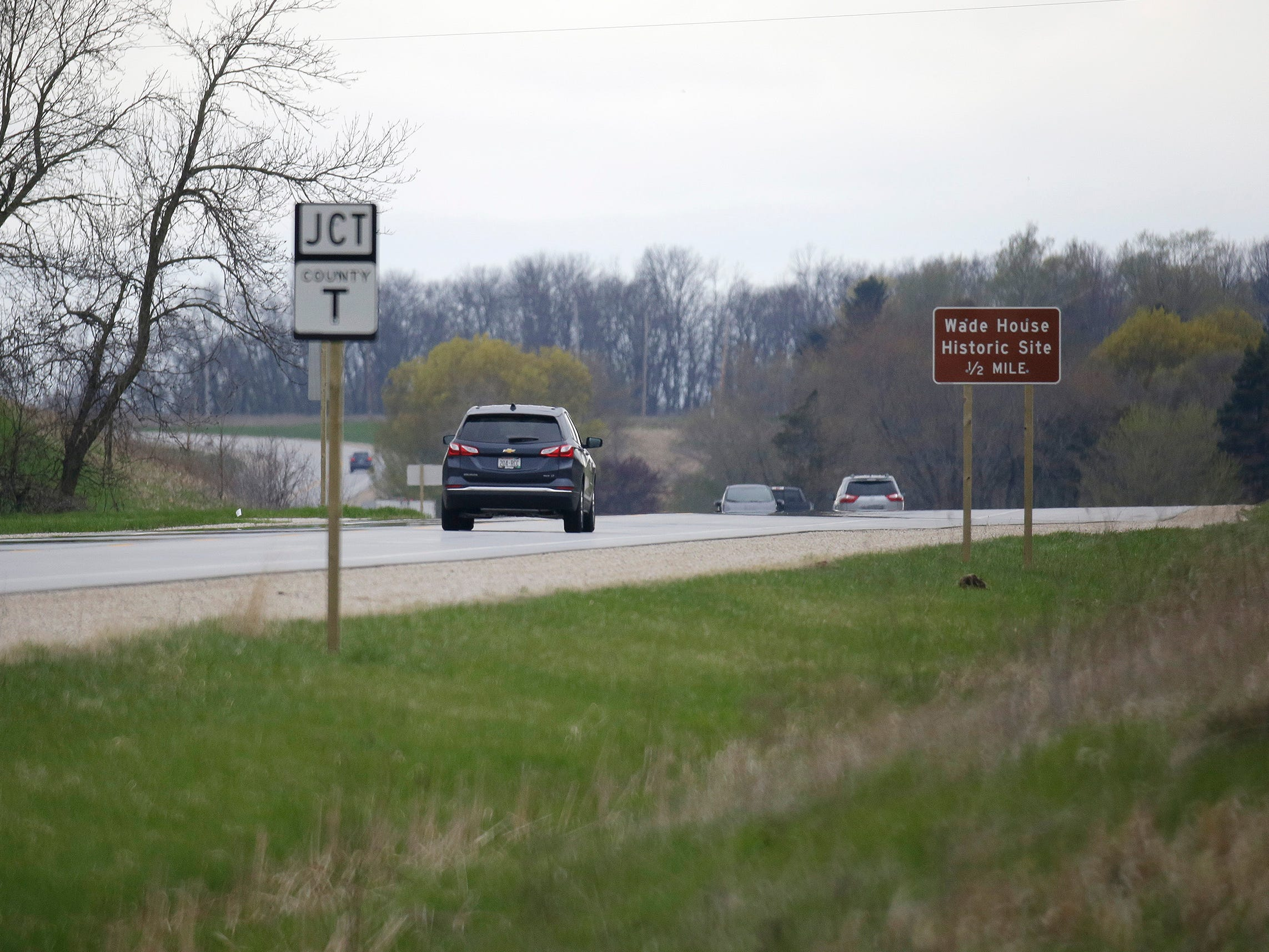 Vehicles travel near the Wade House, Thursday, May 9, 2019, in Greenbush, Wis. State Highway 23 four-lane construction project will start next week.