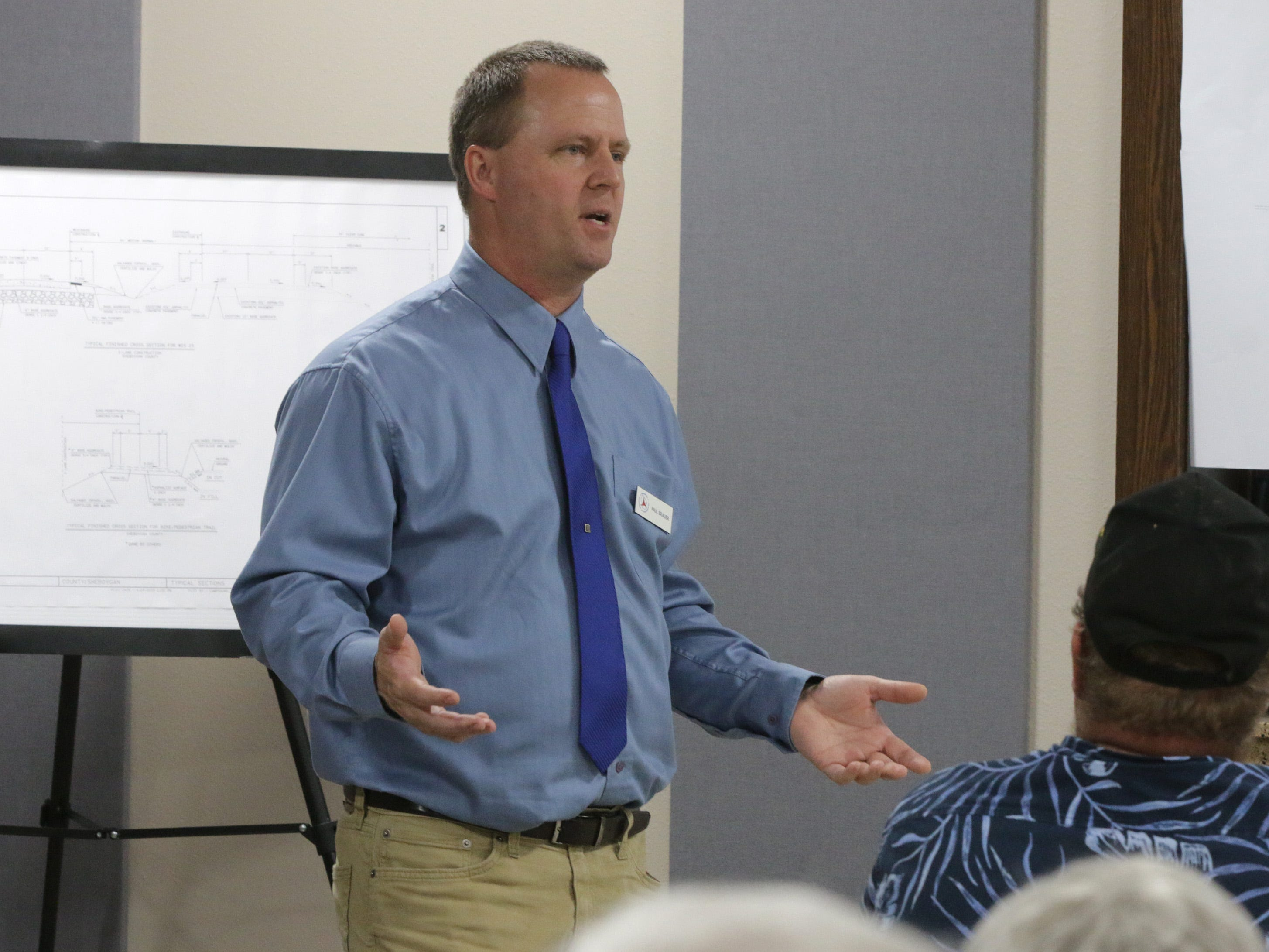 Department of Transportation's Paul Brauer answers questions from people impacted by the state Highway 23 four-lane construction project during a meeting at the Sheboygan County Transportation facility, Thursday, May 9, 2019, in Plymouth, Wis.