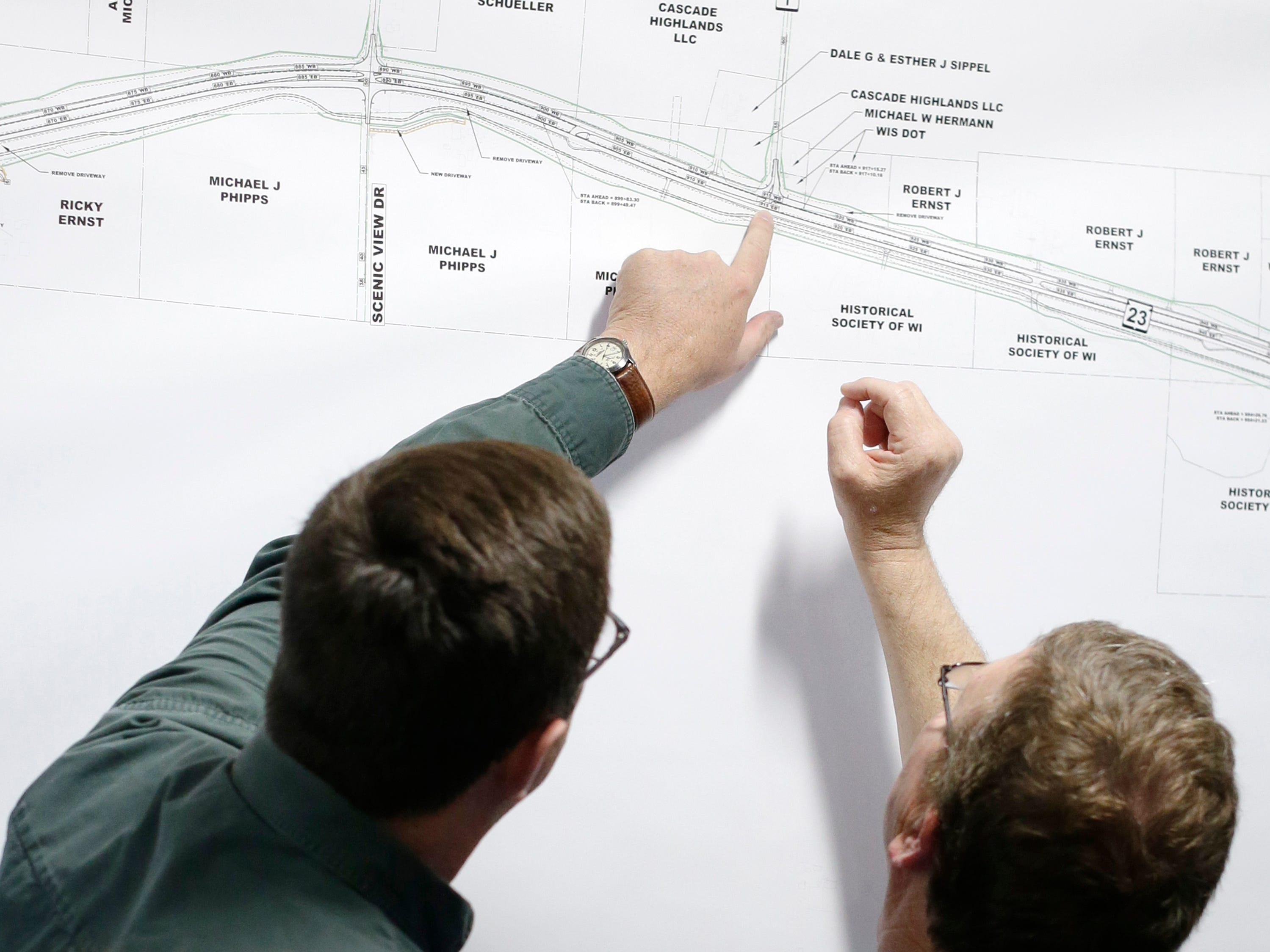 Relyco's Tom Ceske, left, looks over plans with a resident along the state Highway 23 four-lane construction project area during a meeting at the Sheboygan County Transportation facility, Thursday, May 9, 2019, in Plymouth, Wis. Relyco is the contractor for the project.