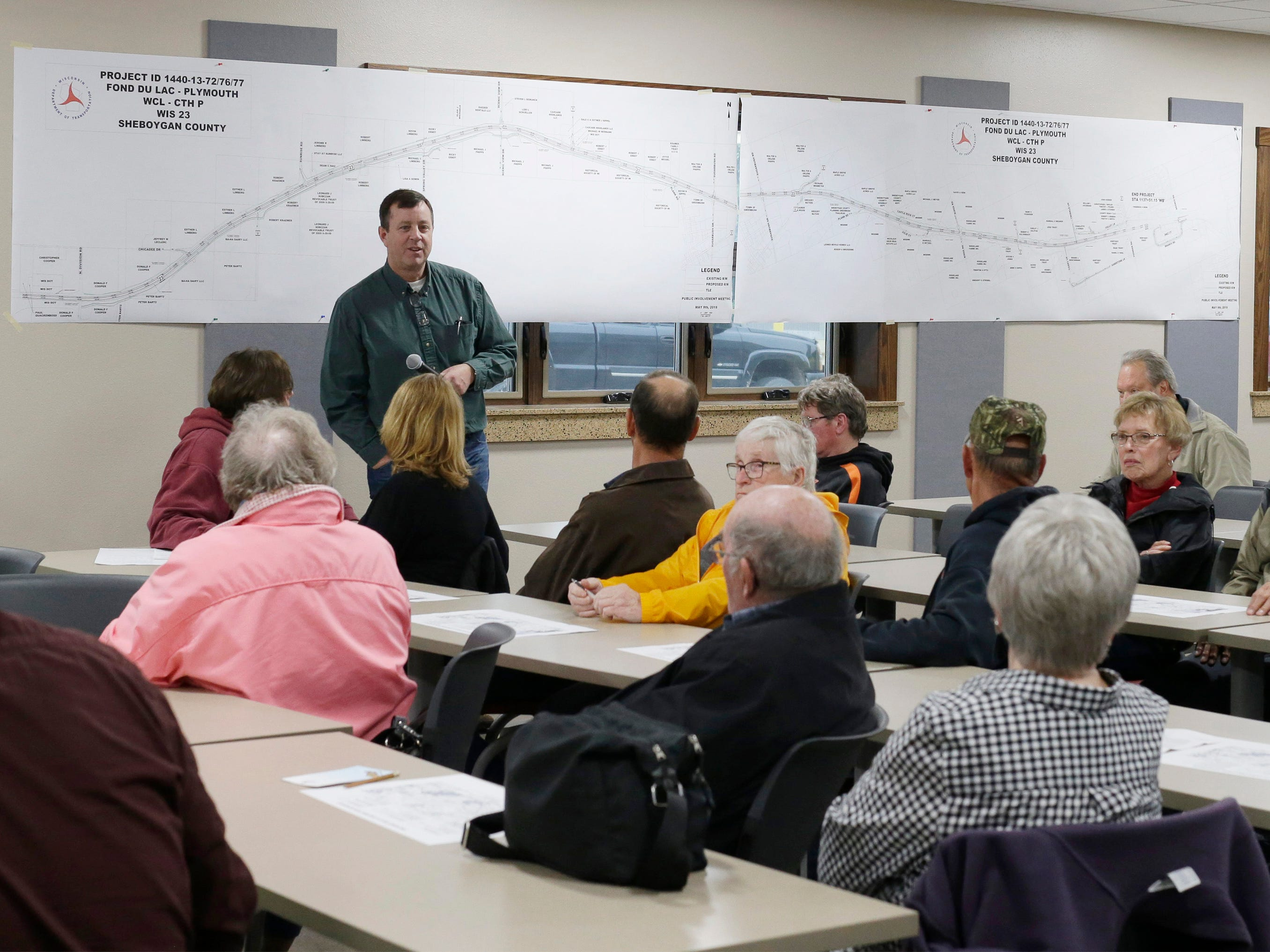 Relyco's Tom Ceske listens to a question from a person impacted by the state Highway 23 four-lane construction project at meeting at the Sheboygan County Transportation facility, Thursday, May 9, 2019, in Plymouth, Wis. Relyco is the project manager for the project.