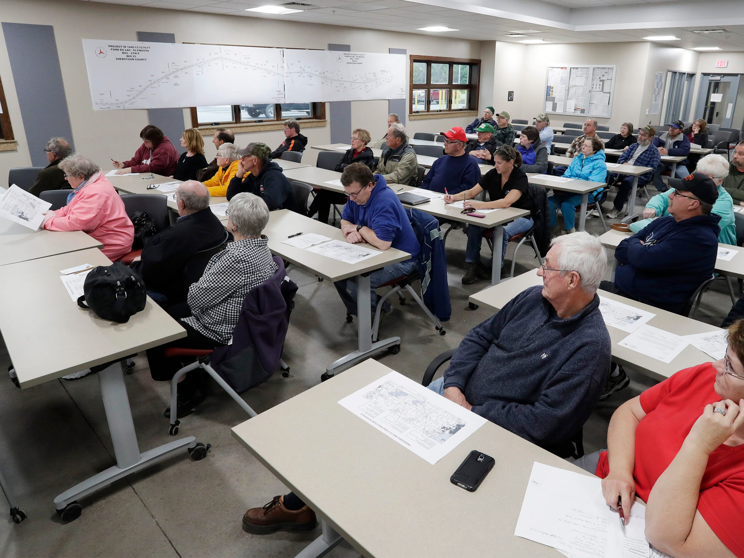 People fill a meeting room at the Sheboygan County Transportation Facility, Thursday, May 9, 2019, in Plymouth, Wis.  DOT officials displayed the construction plans for the state Highway 23 four-lane construction project.