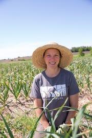 Dakota Fresh board president Kristianna Gehant Siddens, who is also a farmer-member raising organic garlic near Astoria.