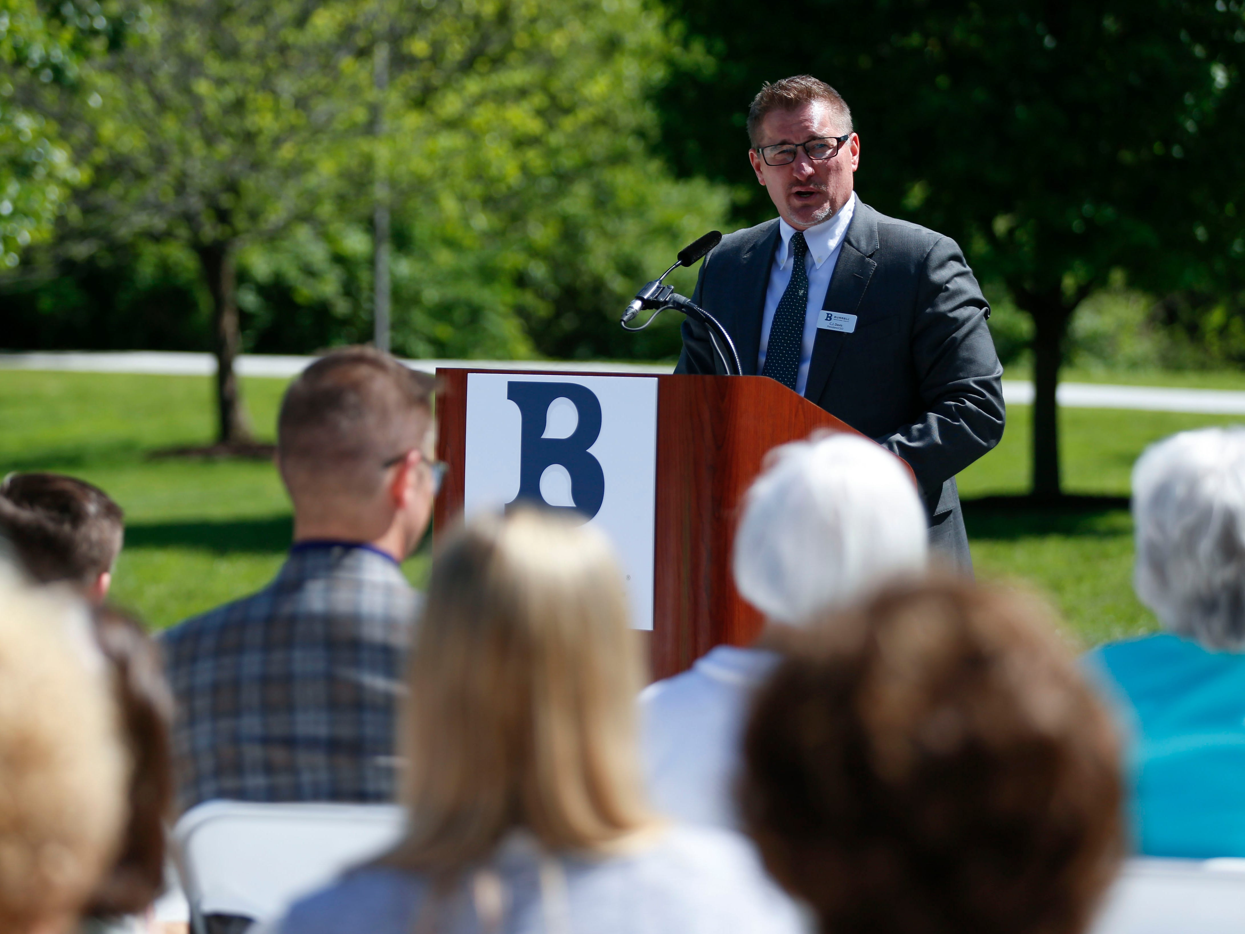 Dr. C.J. Davis, president and CEO of Burrell Behavioral Health, speaks during a dedication ceremony of Schaible Lake, named after Burrell founder, Dr. Todd Schaible, on Friday, May 10, 2019.