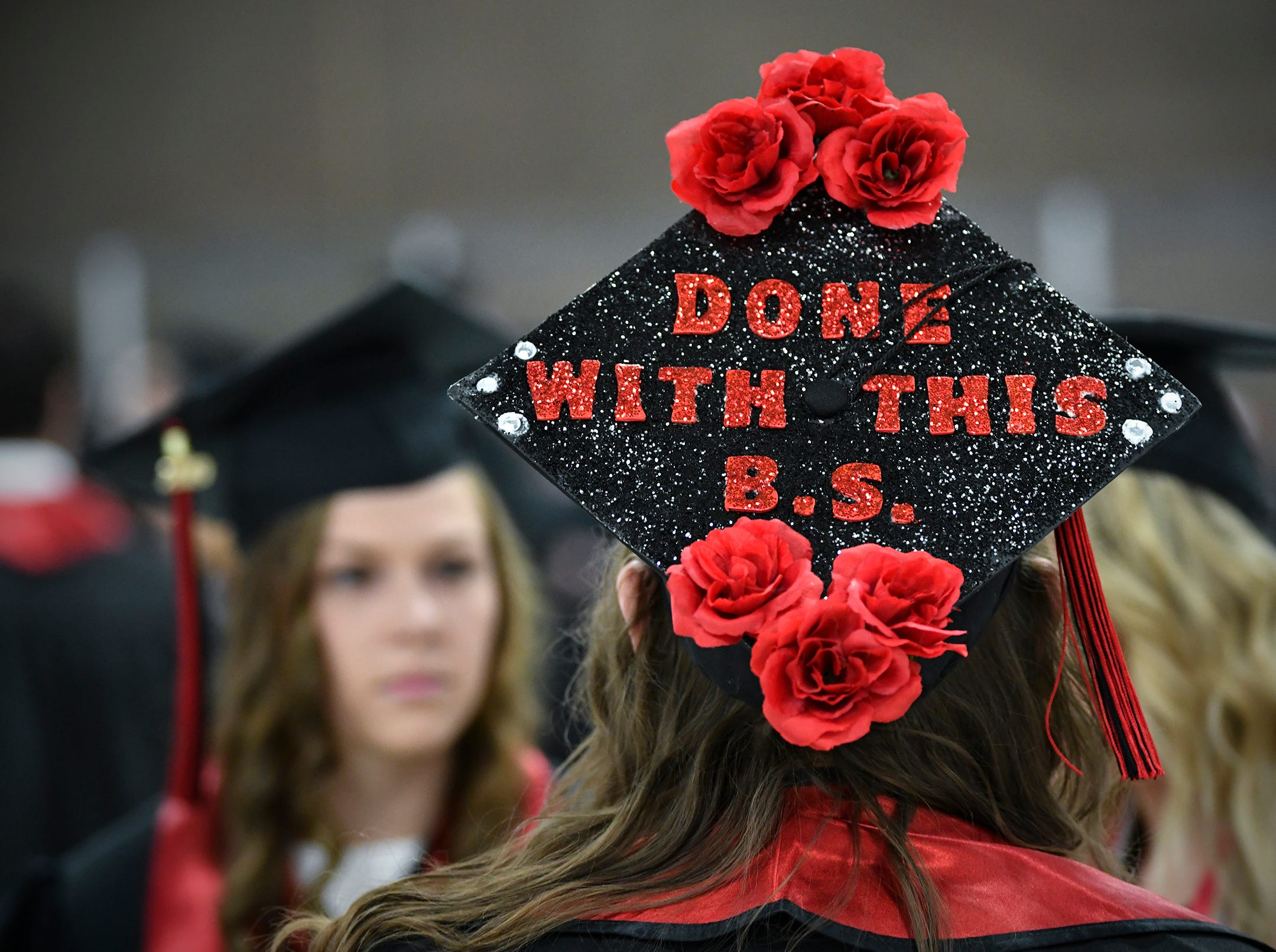 A cleverly-decorated mortar board stands out during the morning commencement ceremony Friday, May 10, in the Herb Brooks National Hockey Center at St. Cloud State University in St. Cloud.