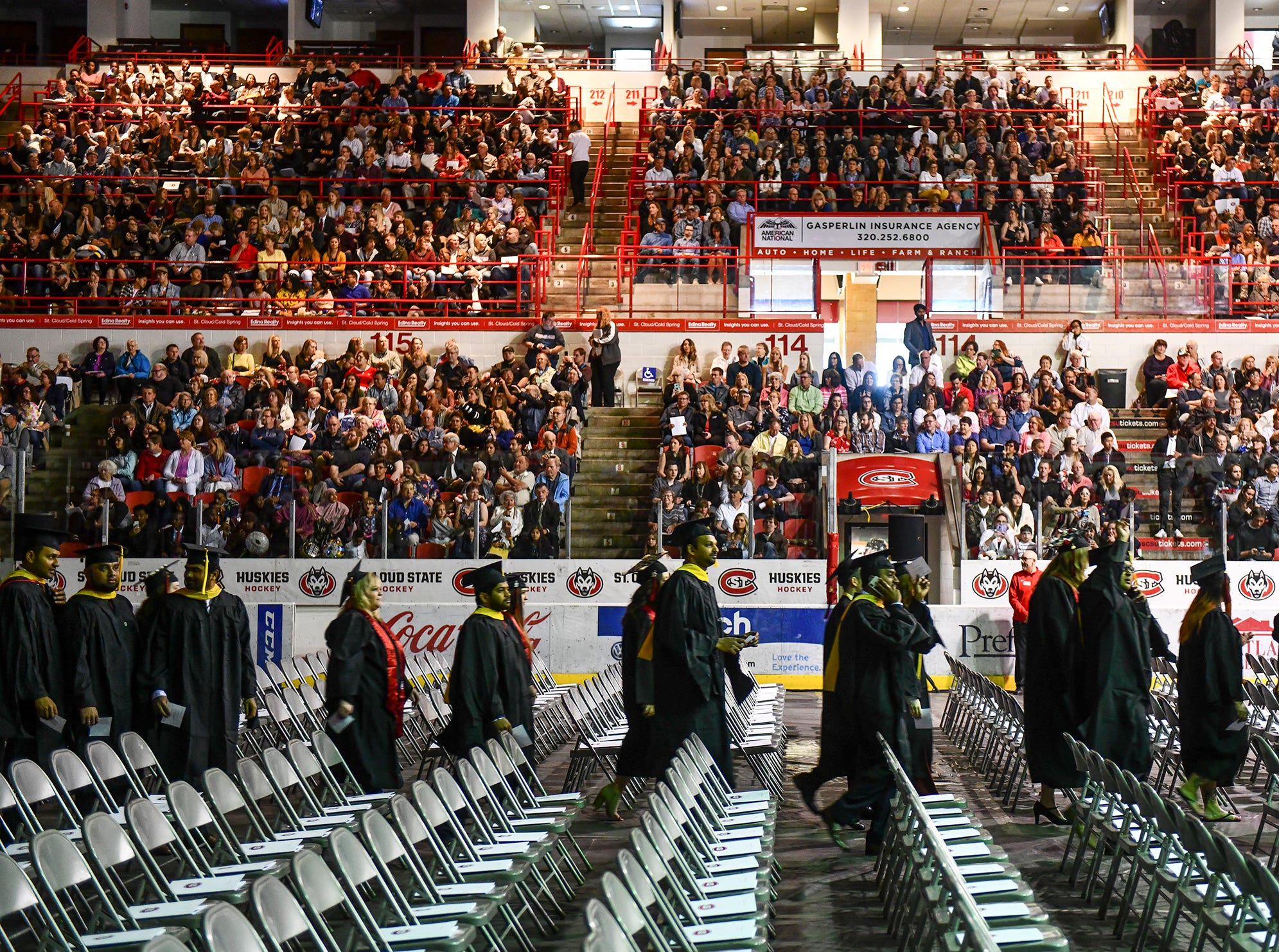 Students take their places during the morning commencement ceremony Friday, May 10, in the Herb Brooks National Hockey Center at St. Cloud State University in St. Cloud.