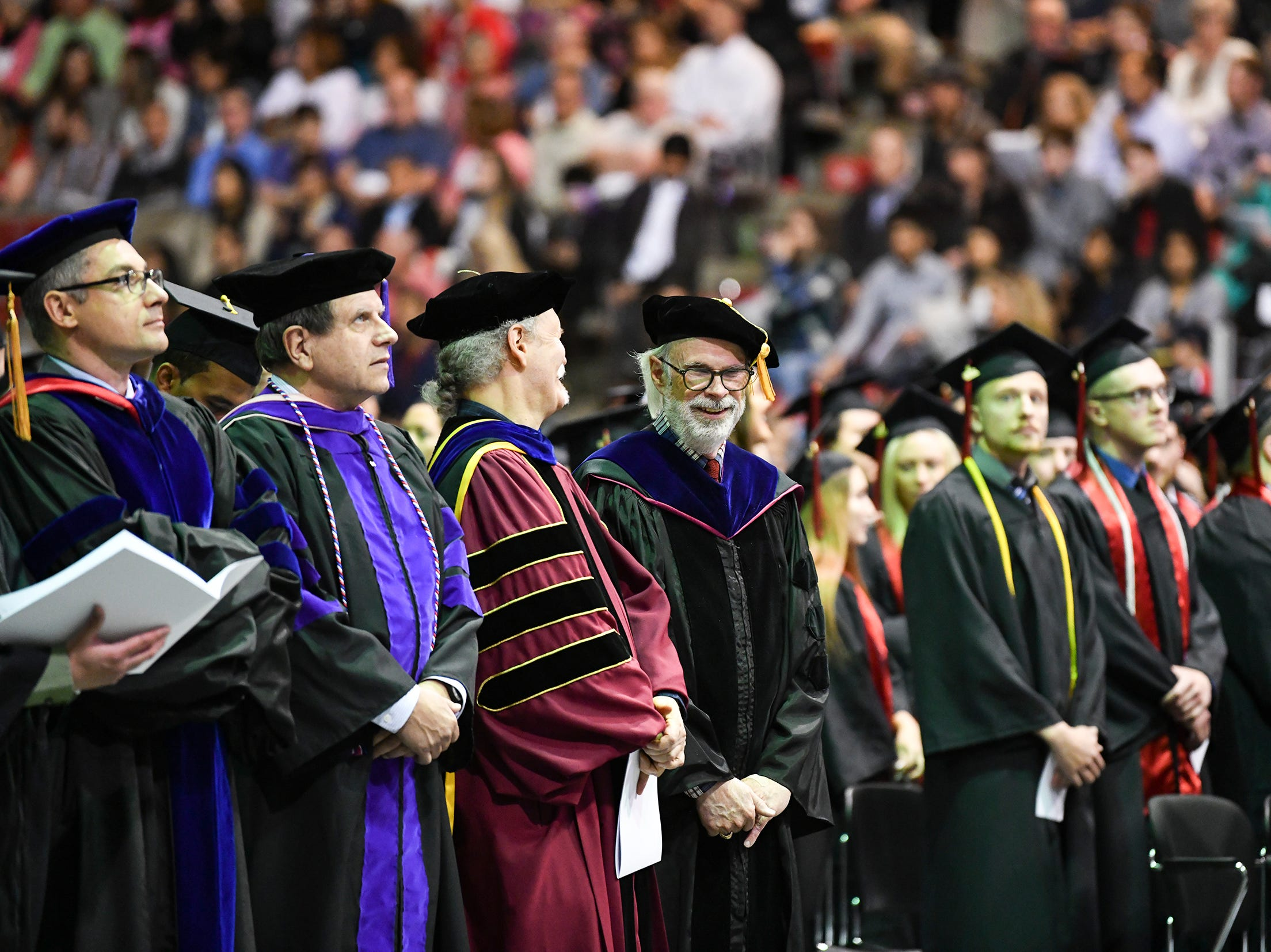 Students and faculty gather for the morning commencement ceremony Friday, May 10, in the Herb Brooks National Hockey Center at St. Cloud State University in St. Cloud.