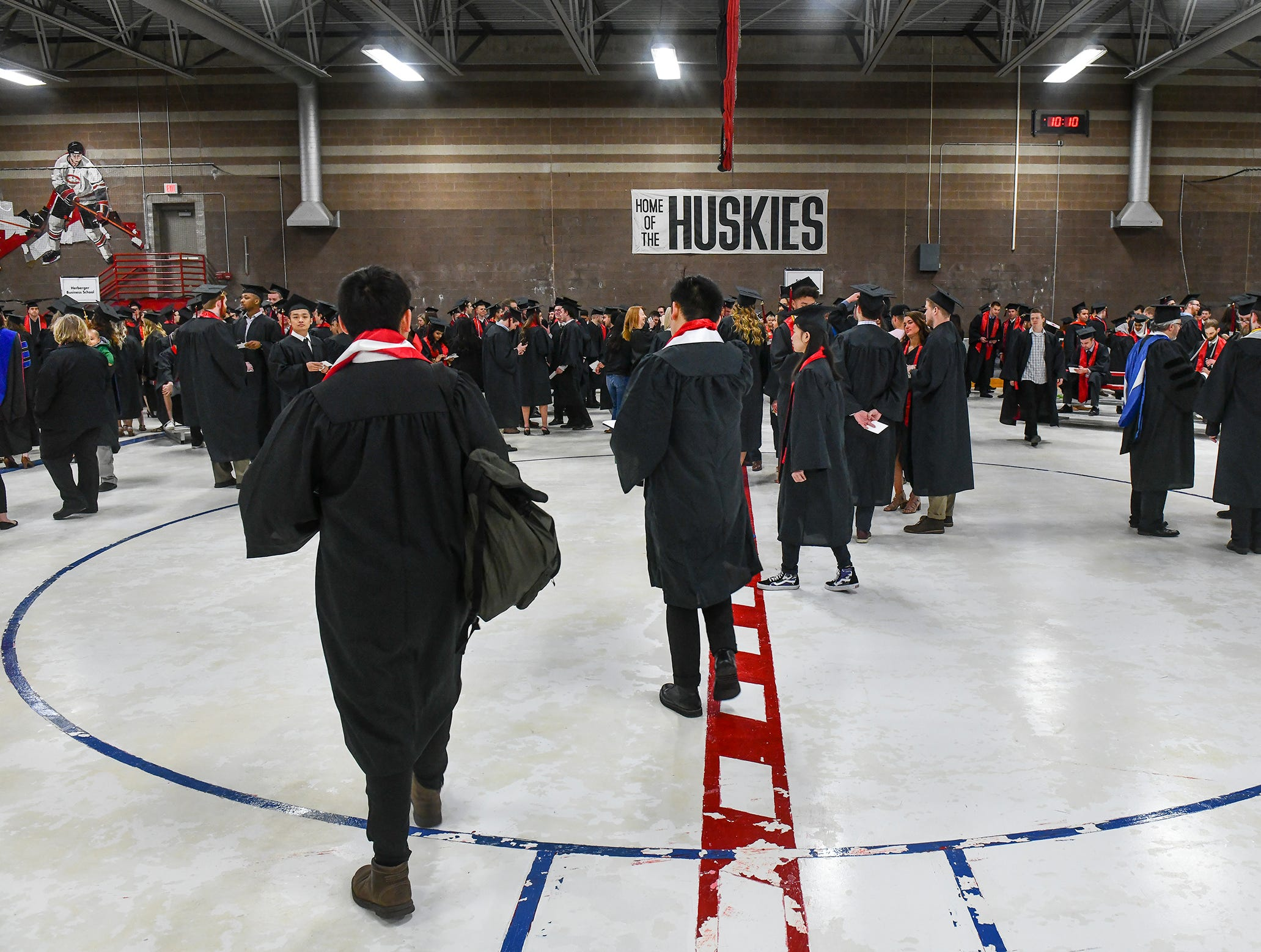 Students gather before the start of the morning commencement ceremony Friday, May 10, in the Herb Brooks National Hockey Center at St. Cloud State University in St. Cloud.
