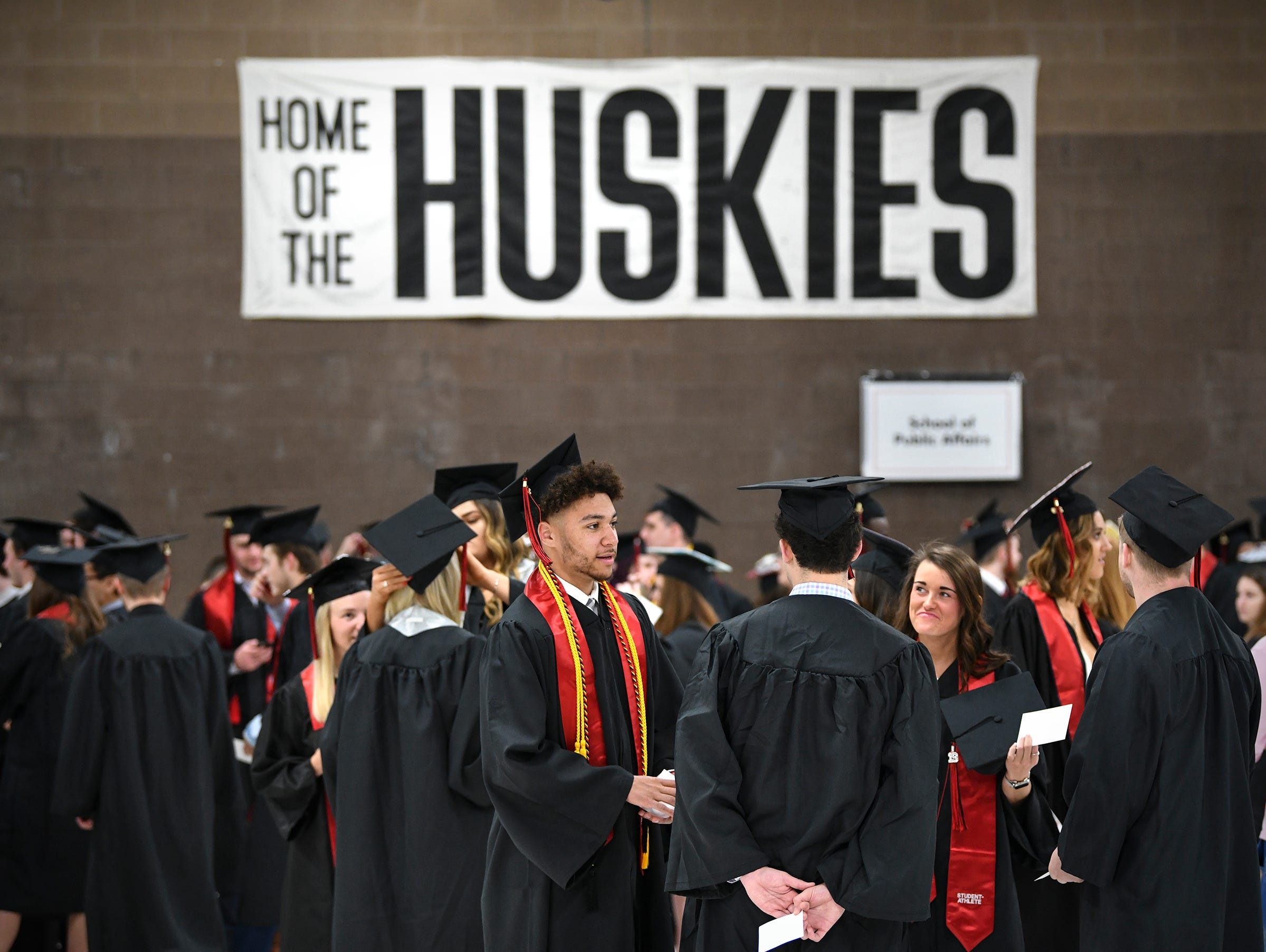 Students gather in the practice rink area before the start of the morning commencement ceremony Friday, May 10, in the Herb Brooks National Hockey Center at St. Cloud State University in St. Cloud.