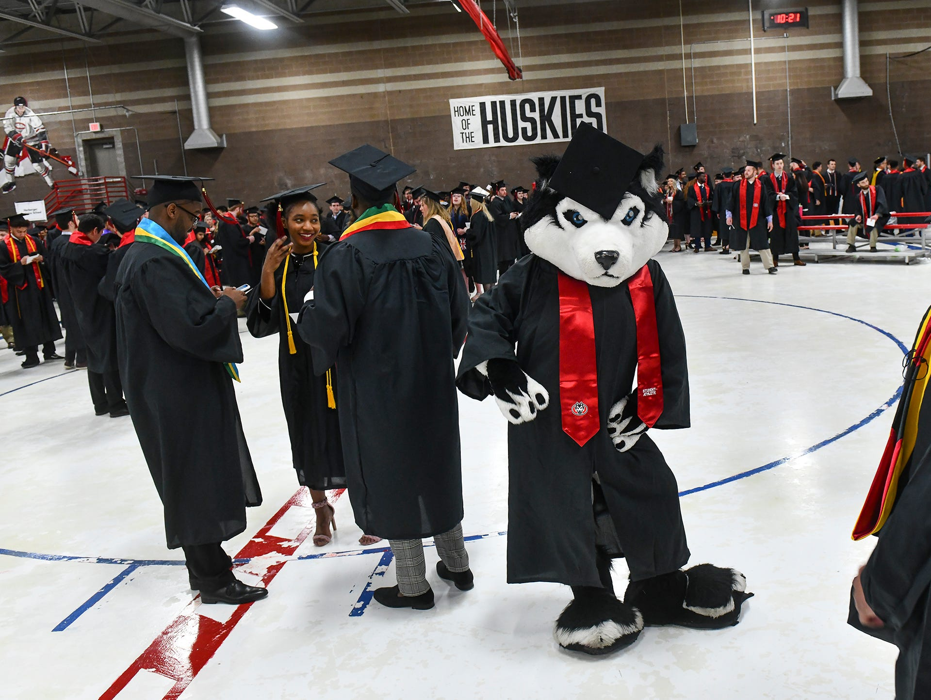 School mascot Blizzard poses for a photo in full cap and gown before the start of the morning commencement ceremony Friday, May 10, in the Herb Brooks National Hockey Center at St. Cloud State University in St. Cloud.