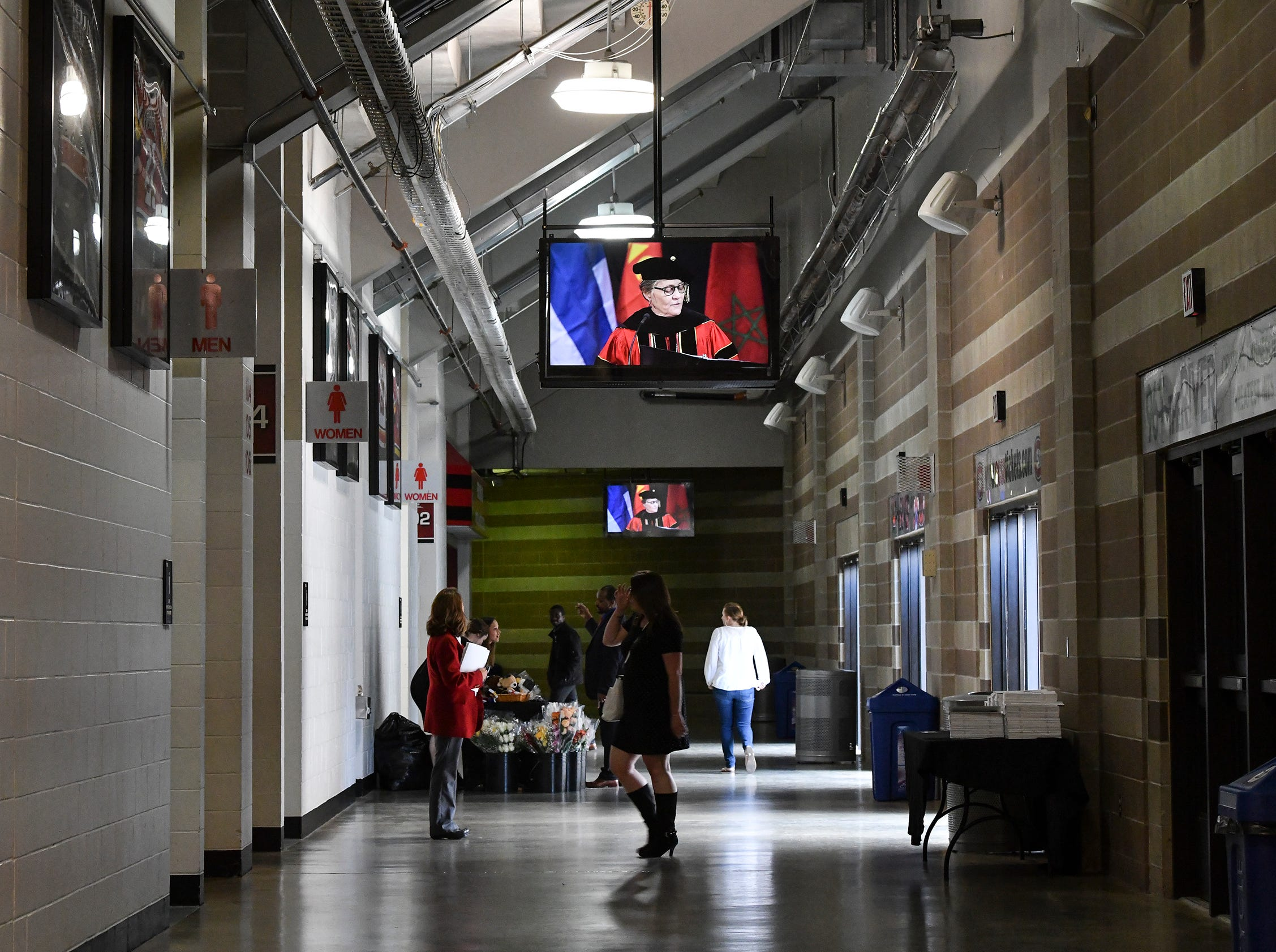 The image of university president Robbyn Wacker is projected on televisions in the hallway of the Herb Brooks National Hockey Center during commencement exercises Friday, May 10, in St. Cloud.
