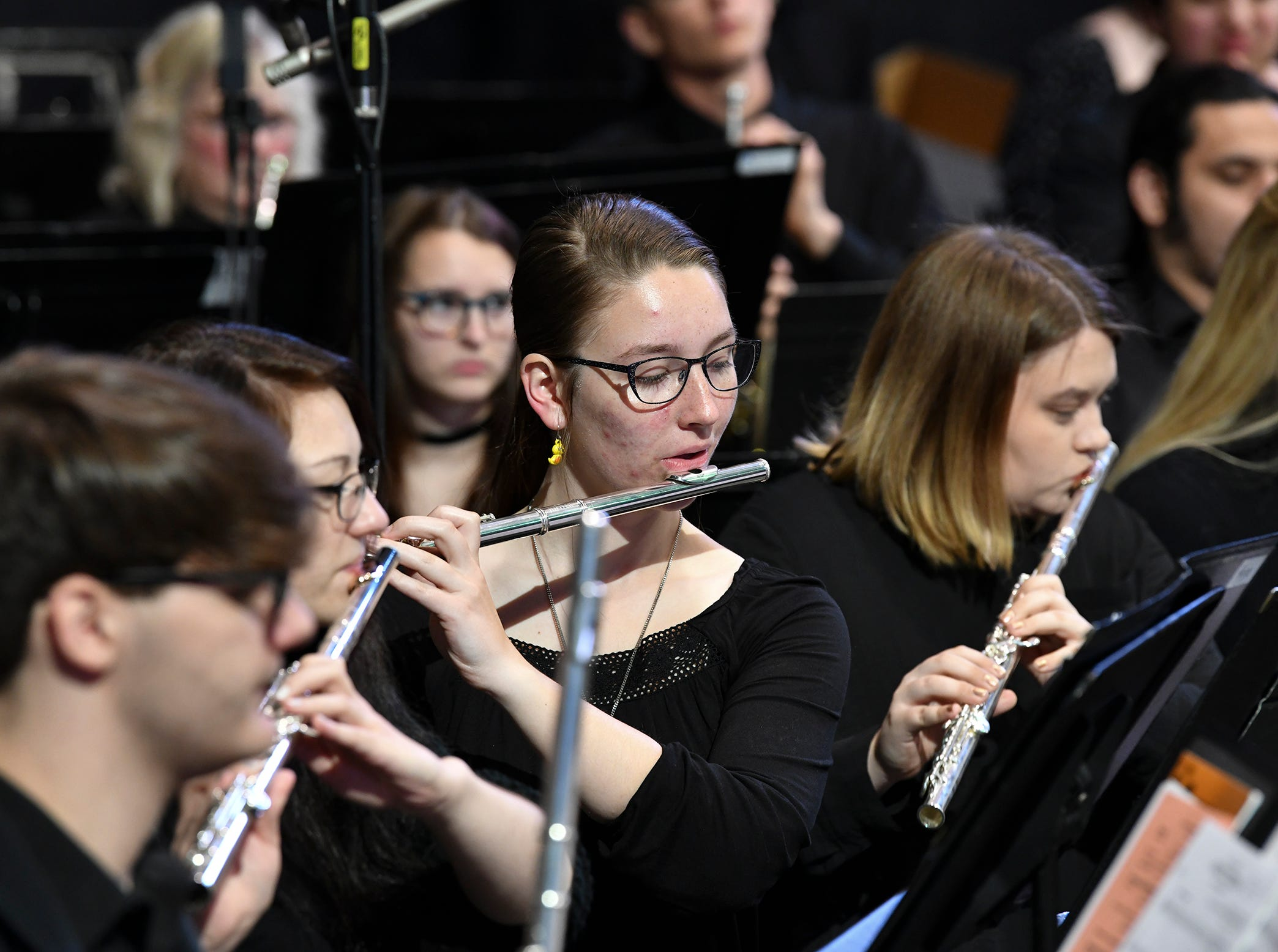 The St. Cloud State University Wind Ensemble performs before the start of the morning commencement ceremony Friday, May 10, in St. Cloud.