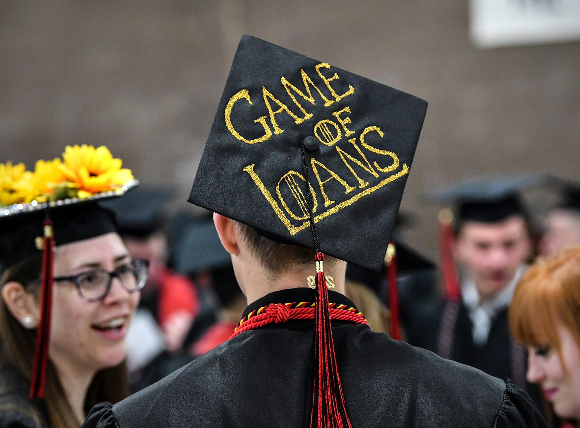 Decorated mortar boards of many types are on display during the morning commencement ceremony Friday, May 10, in the Herb Brooks National Hockey Center at St. Cloud State University in St. Cloud.