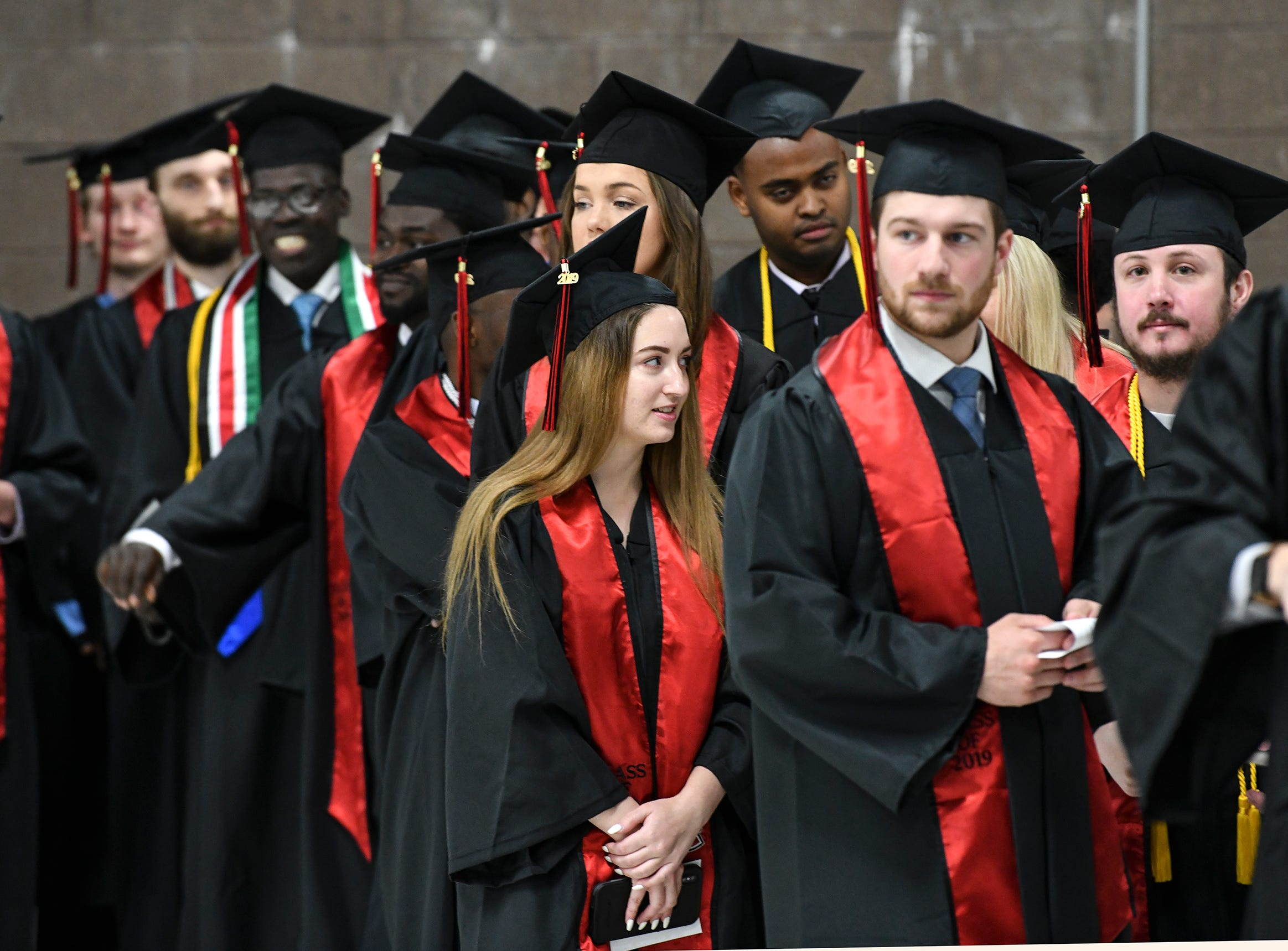 Students take their places for the morning commencement ceremony Friday, May 10, in the Herb Brooks National Hockey Center at St. Cloud State University in St. Cloud.