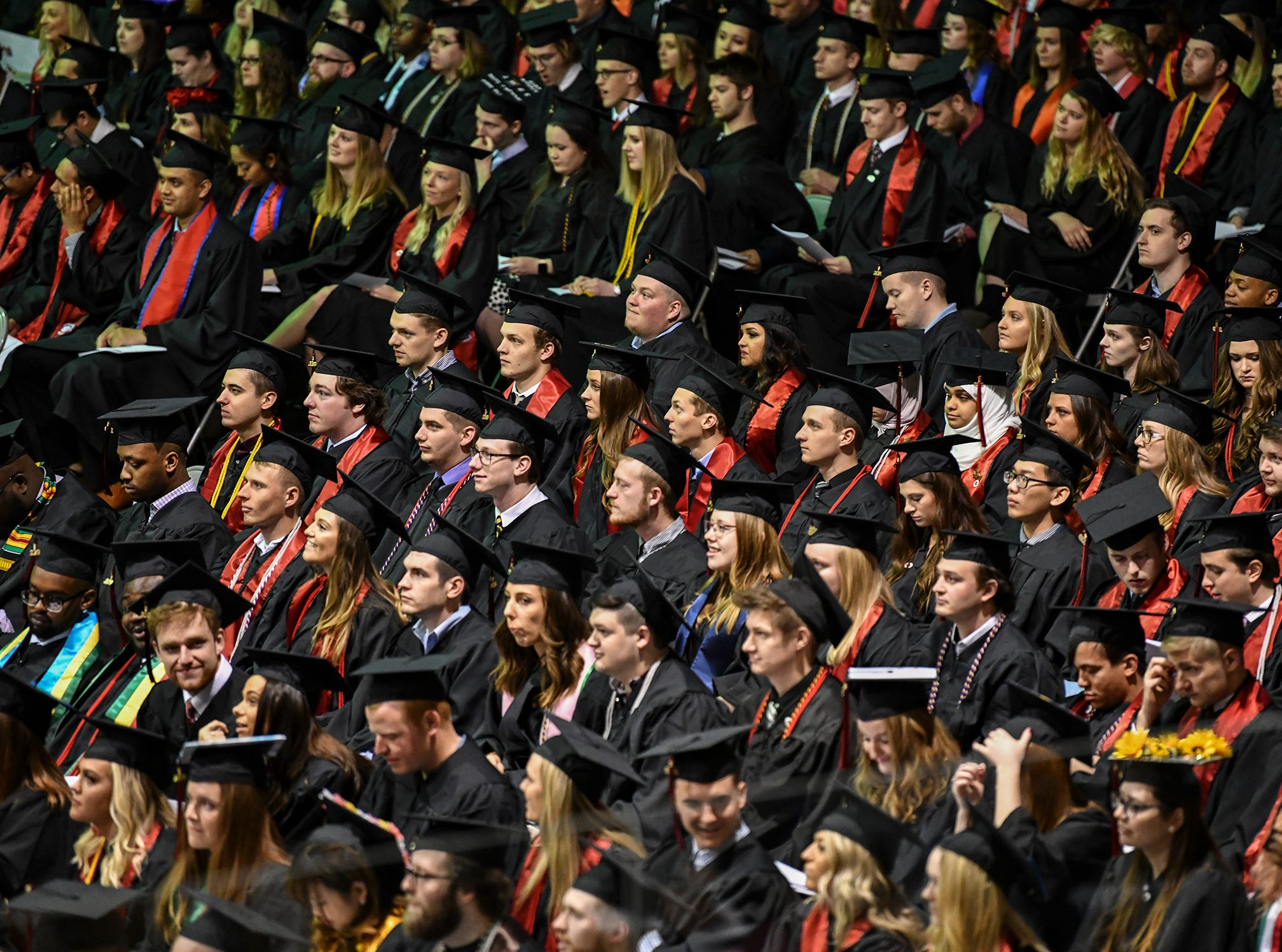 St. Cloud State University students wait to receive their degrees during the morning commencement ceremony Friday, May 10, in St. Cloud.